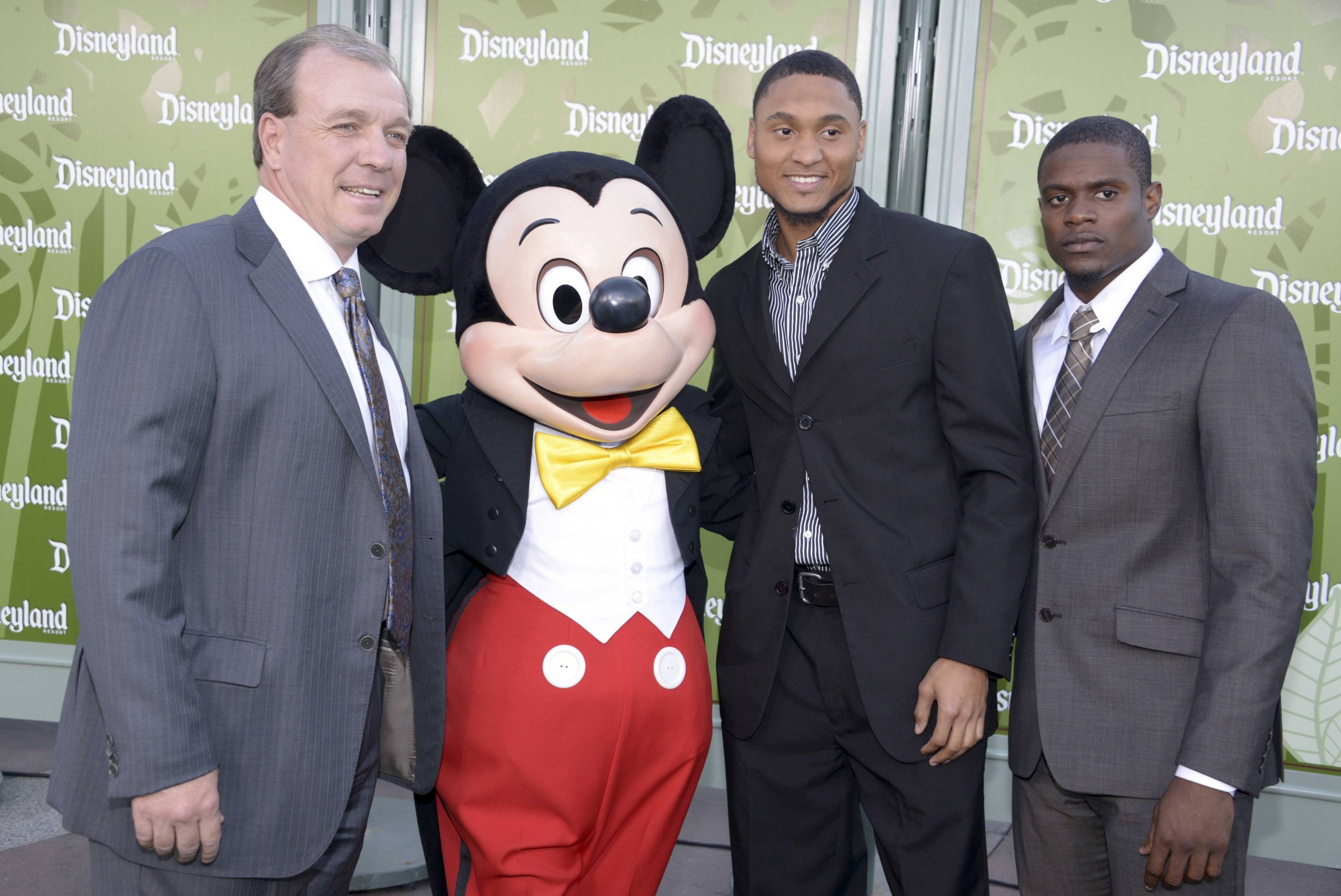 Florida State Seminoles coach Jimbo Fisher (left) poses with Mickey Mouse (second from left) and receiver Rashad Greene (second from right) and defensive back Lamarcus Joyner at a press conference for the 2014 BCS National Championship at ESPN Zone Downtown Disney. Mandatory Credit: Kirby Lee-USA TODAY Sports