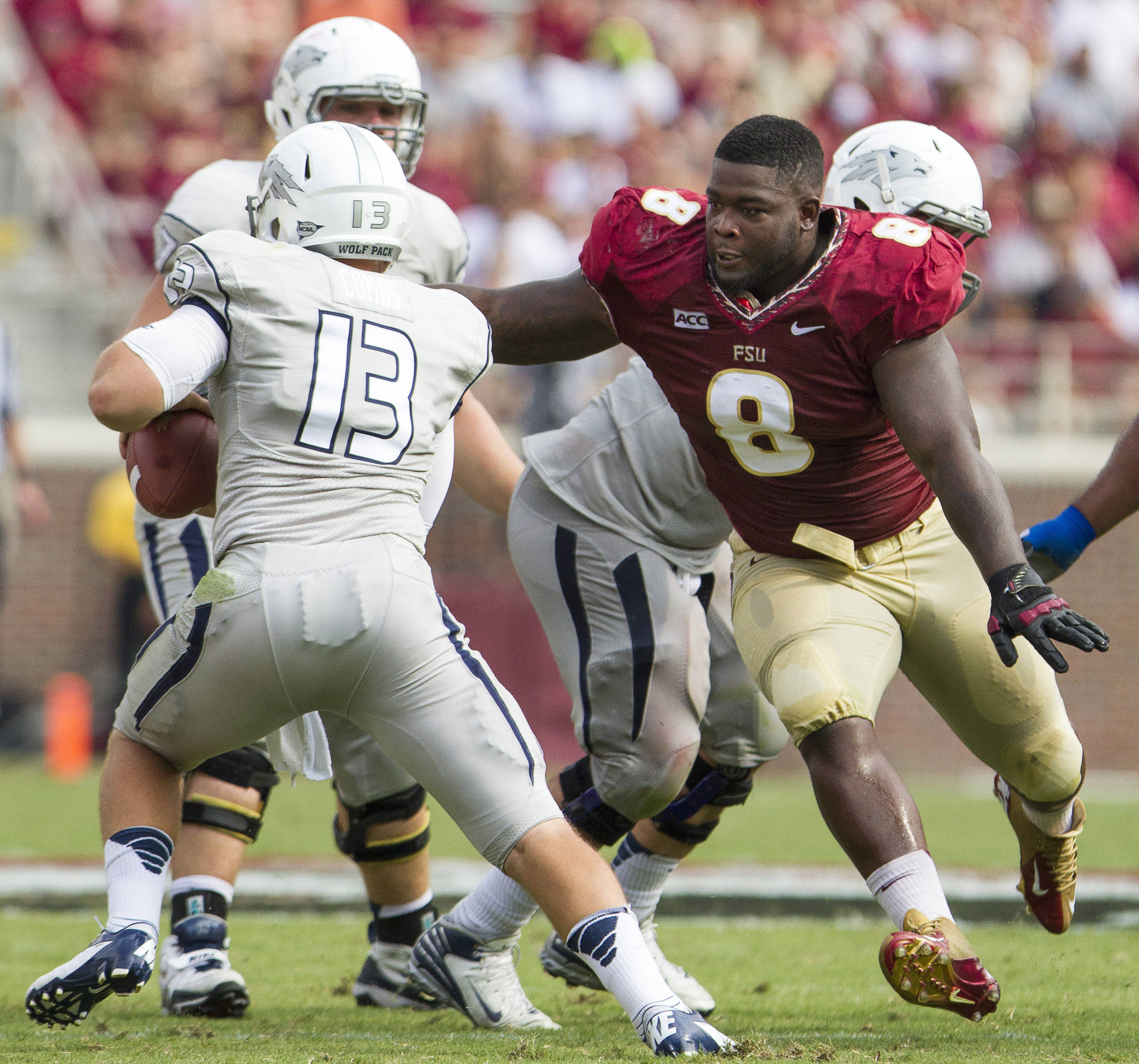 Timmy Jernigan (8) runs after a the ball carrier during FSU's 62-7 win over Nevada on Saturday, Sept 14, 2013 in Tallahassee, Fla.