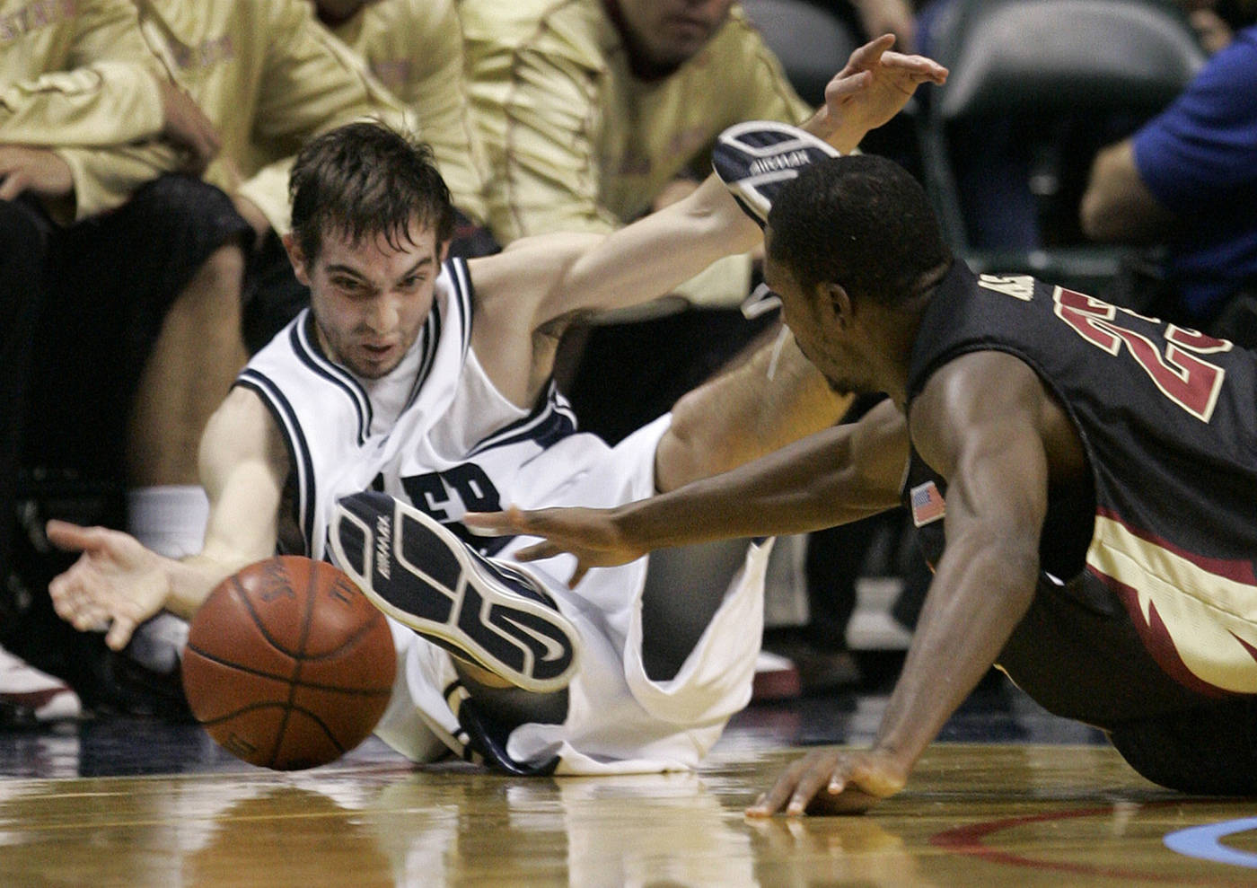 Butler's A.J. Graves and Toney Douglas scramble on the floor for a loose ball in the second half. (AP Photo/Michael Conroy)