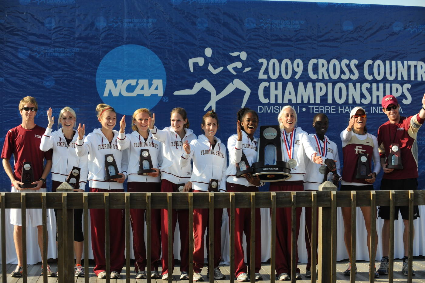 The women's cross country team celebrates their second place finish at the NCAA Championships.