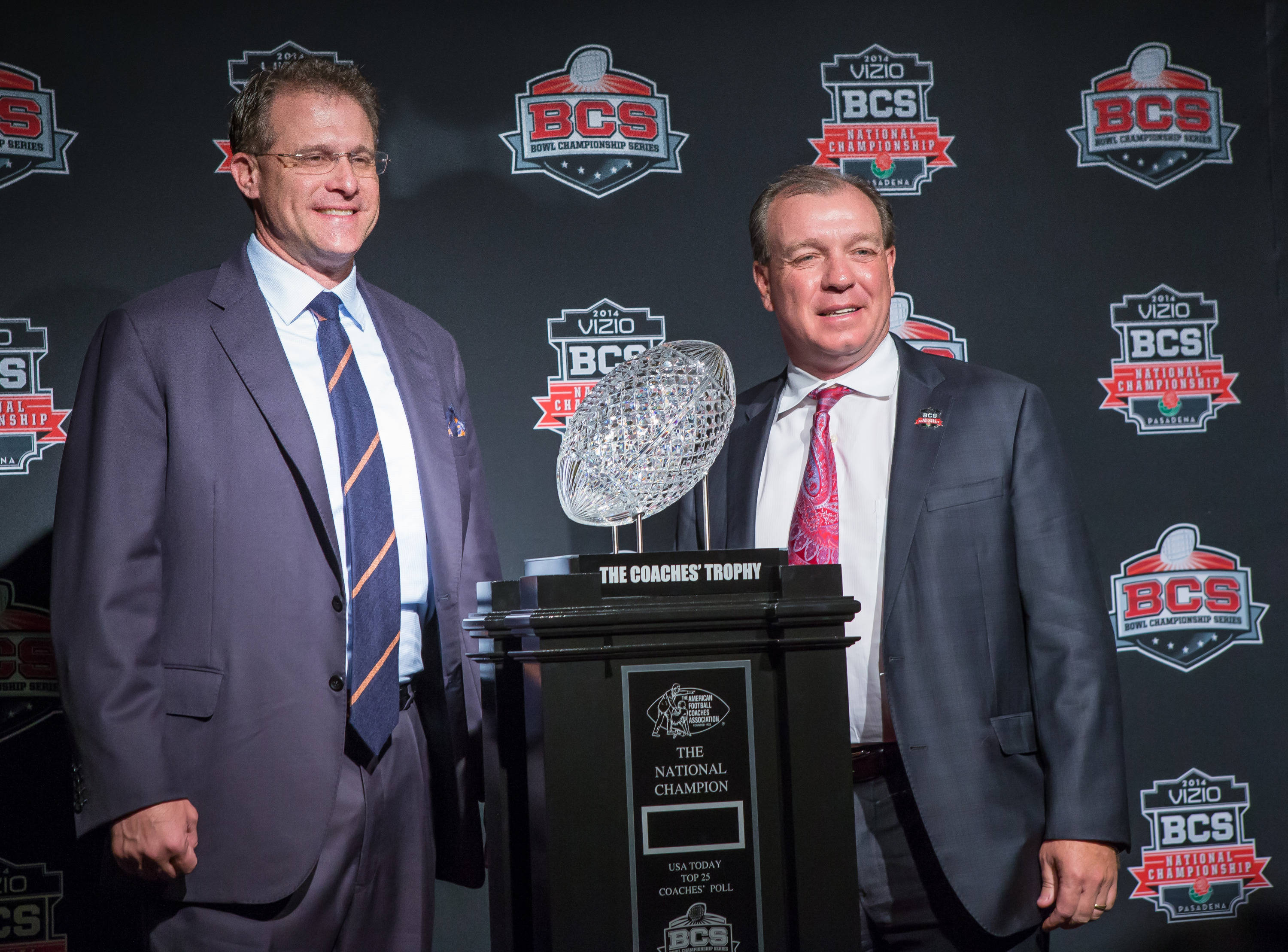 Jimbo Fisher and Auburn Coach Gus Malzahn pose with the Championship Trophy.