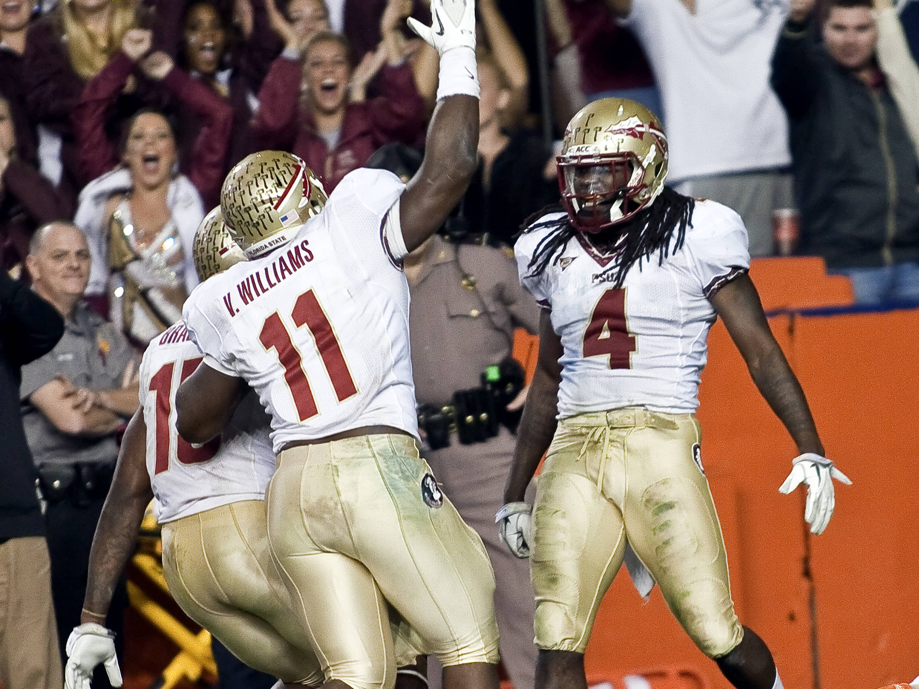 Terrance Parks (4) celebrates his pick-6 to seal the victory for the Noles over the Gators in the Swamp.  It marked Florida State's first victory in Gainesville since 2003.