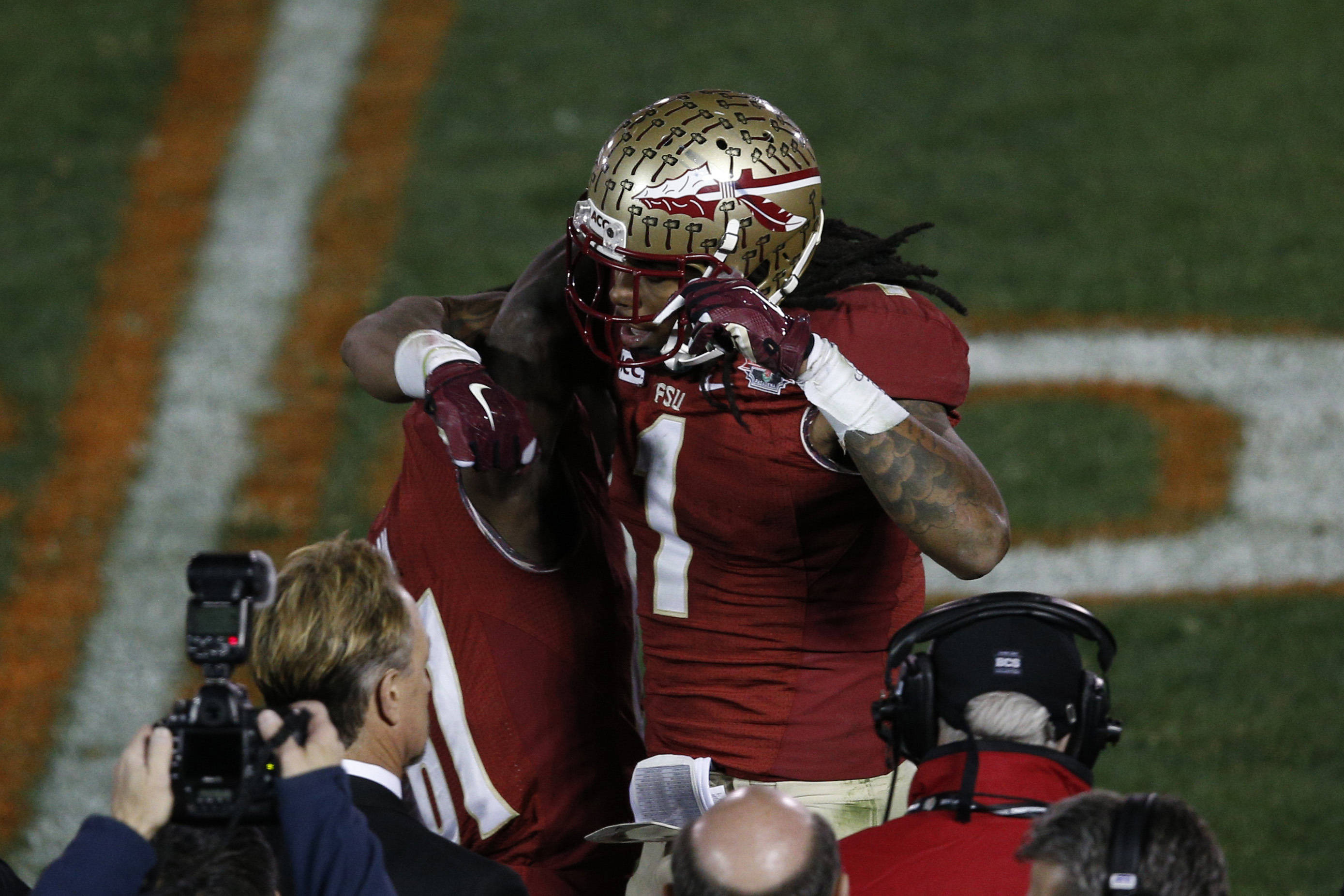 Jan 6, 2014; Pasadena, CA, USA; Florida State Seminoles wide receiver Kelvin Benjamin (1) celebrates after scoring a touchdown against the Auburn Tigers during the second half of the 2014 BCS National Championship game at the Rose Bowl.  Mandatory Credit: Kelvin Kuo-USA TODAY Sports