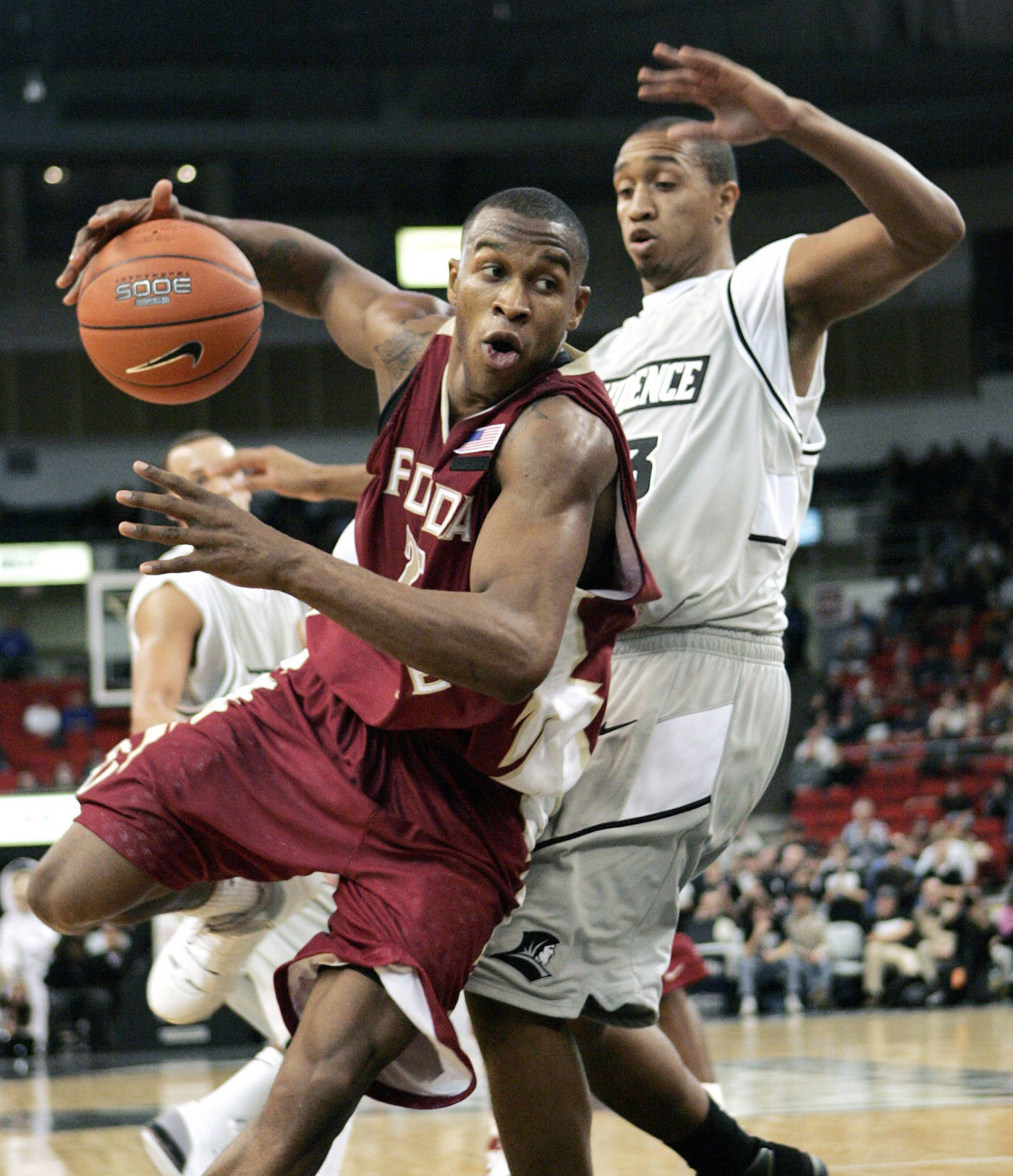 Florida State's Jason Rich drives past Providence's Charles Burch in the second half.