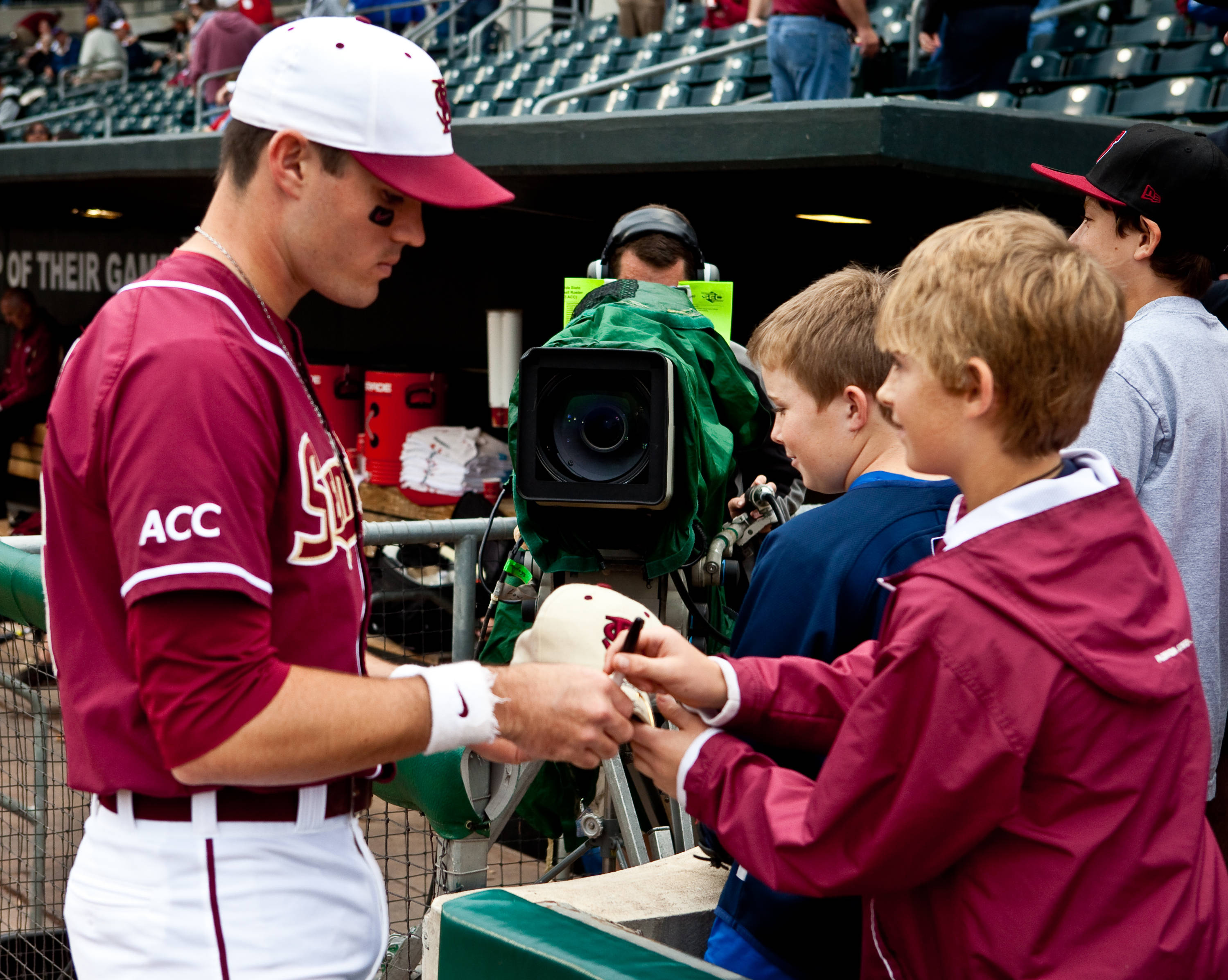 Jayce Boyd (16) signs a ball for some young fans
