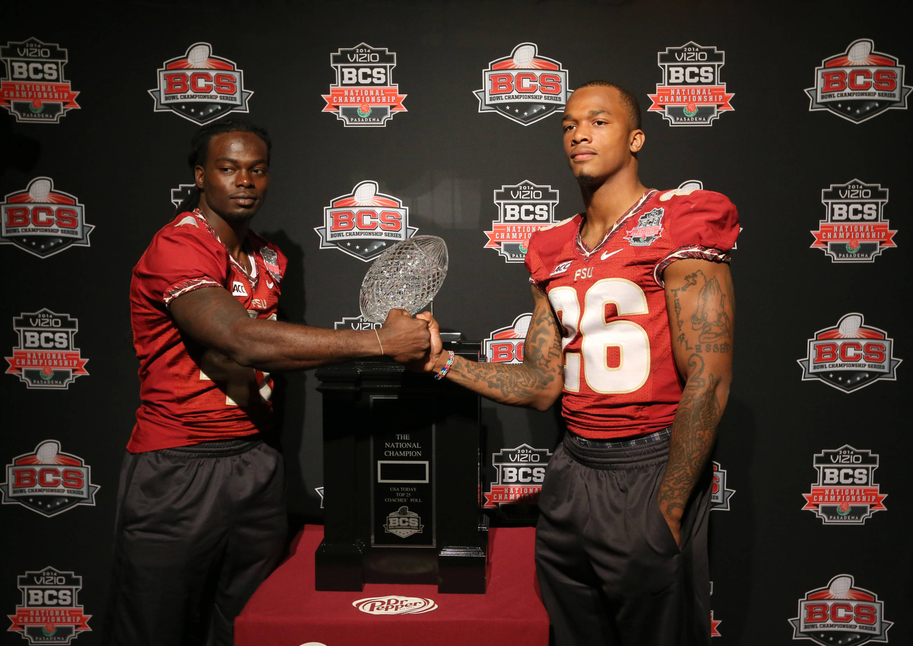 Jan 4, 2014; Newport Beach, CA, USA; Seminoles cornerback Donovan Todd (41) and P.J. Williams (26) poses for a photo with the Coaches' Trophy during Media Day at Newport Beach Marriott. Matthew Emmons-USA TODAY Sports