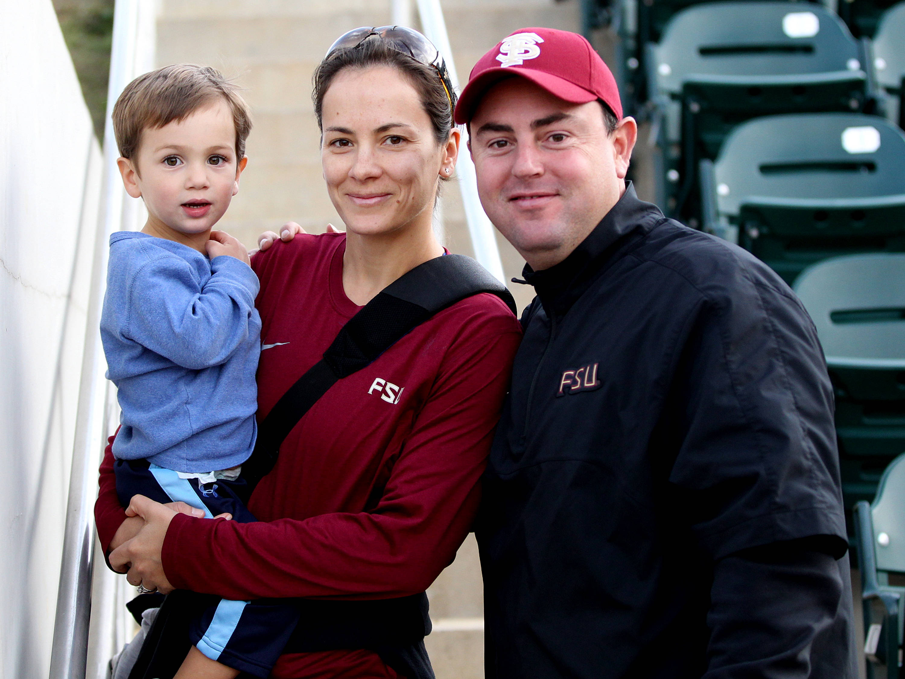 Assistant Coach Travis Wilson with his wife Jill and son Tyler, FSU vs FIU 03/12/13. (Photo by Steve Musco)