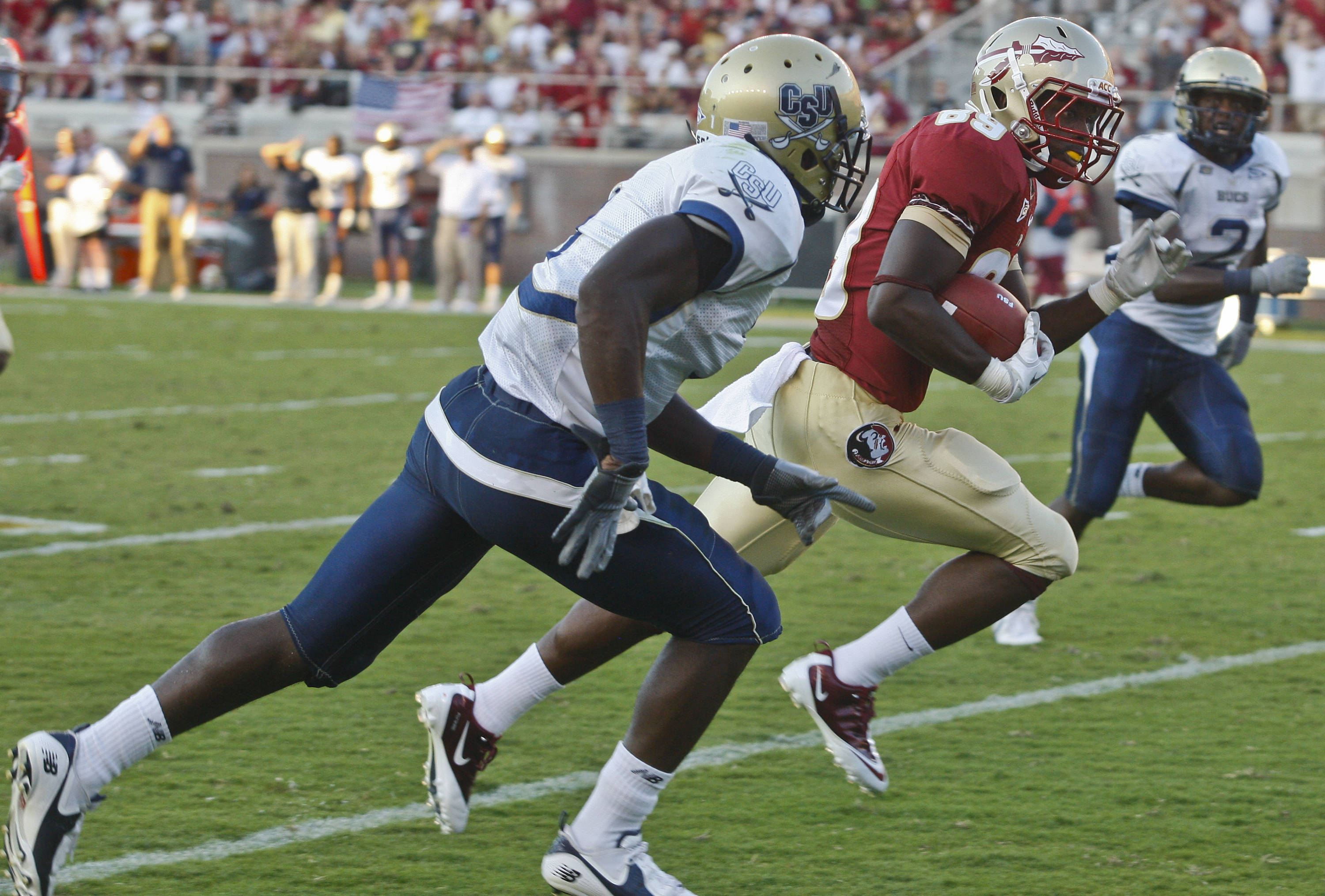 Florida State wide receiver Christian Green (89) makes a 53-yard gain after a catch as Charleston Southern defensive backs Charles James (1) and O'Brian Campbell (2) chase him in the second quarter of an NCAA college football game on Saturday, Sept. 10, 2011, in Tallahassee, Fla. FSU won 62-10. (AP Photo/Phil Sears)