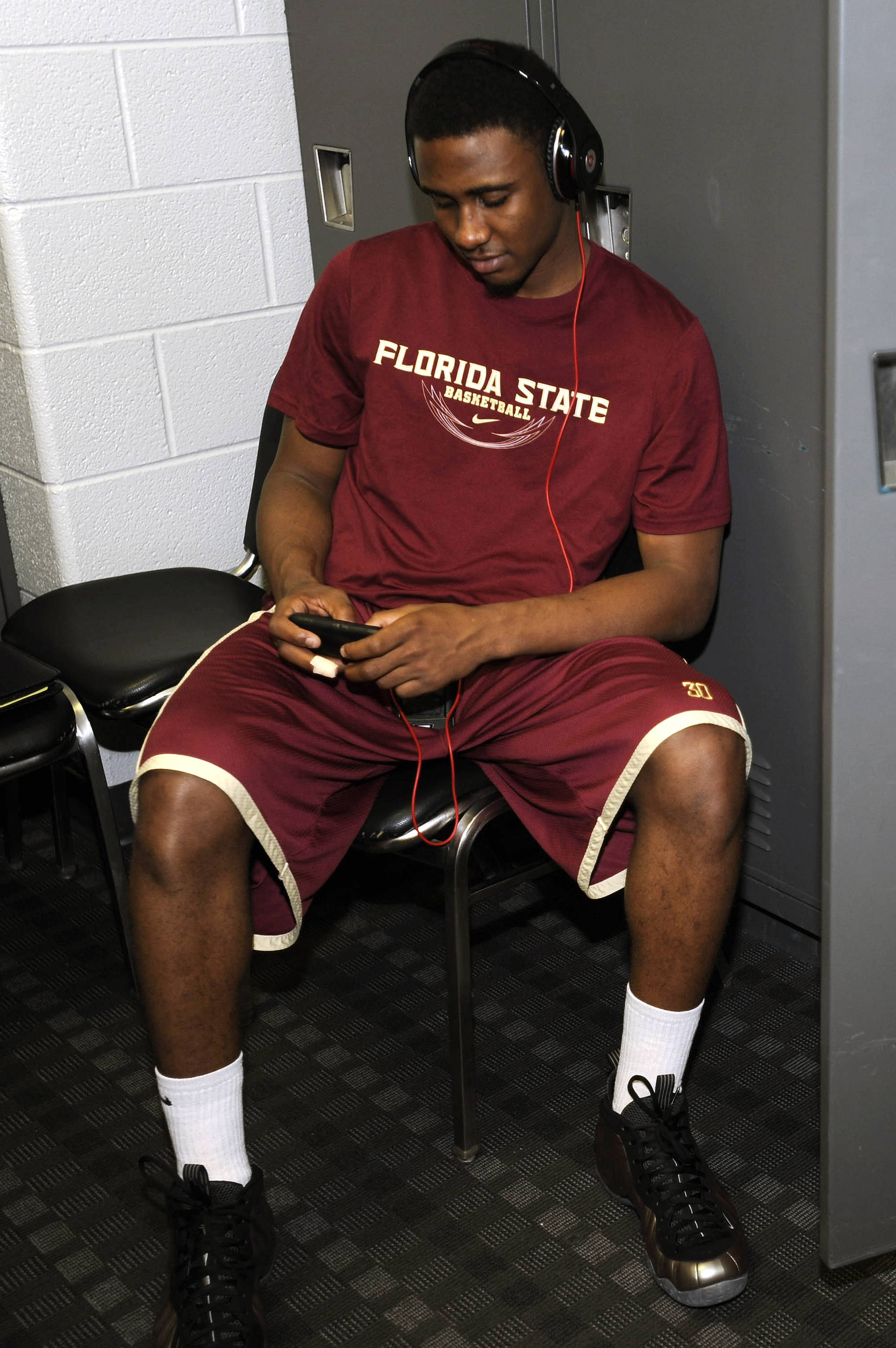 Ian Miller listens to some music before practice