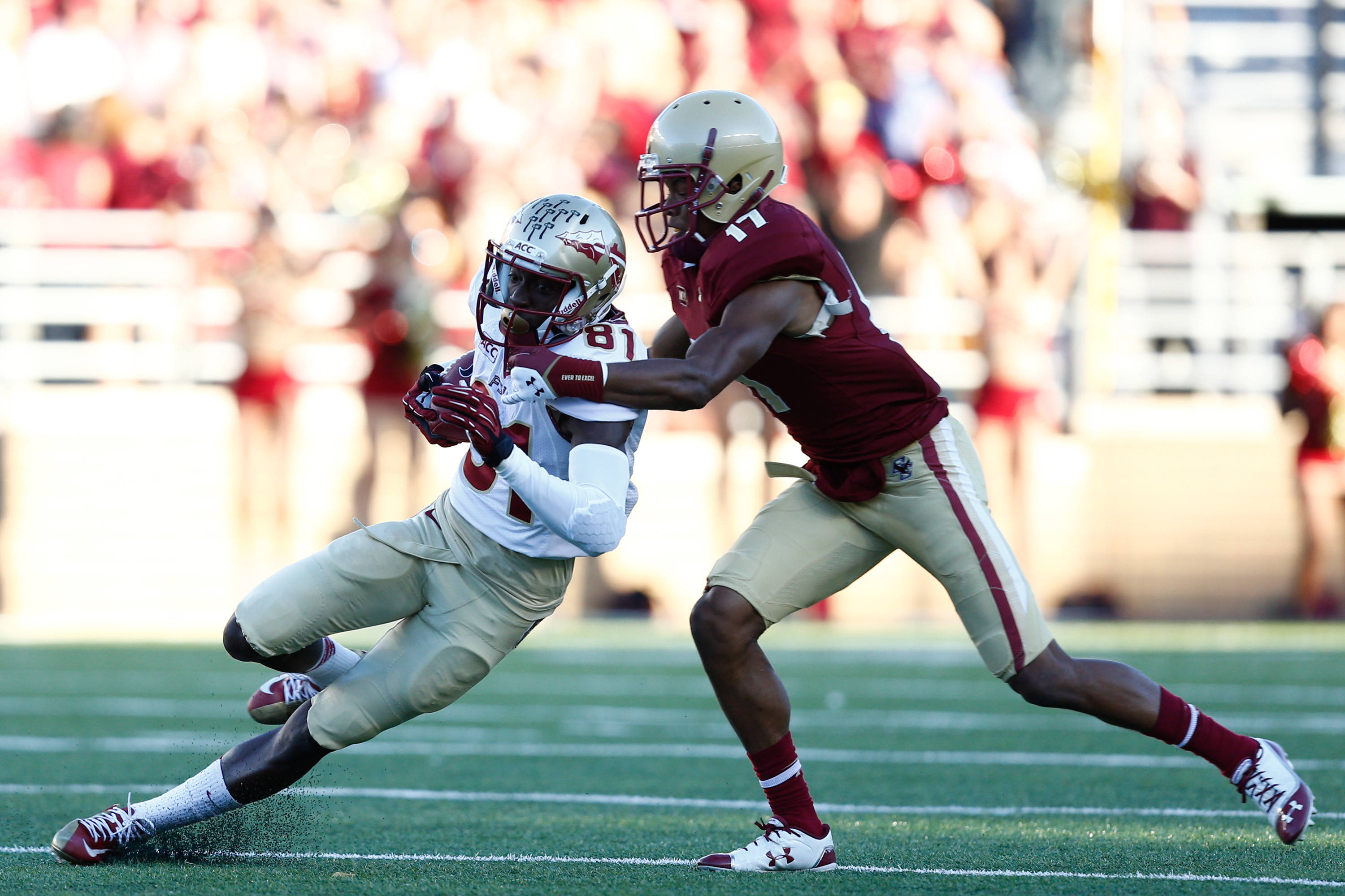 Kenny Shaw (81) carries the ball against Boston College Eagles defensive back Bryce Jones (17). Mandatory Credit: Mark L. Baer-USA TODAY Sports
