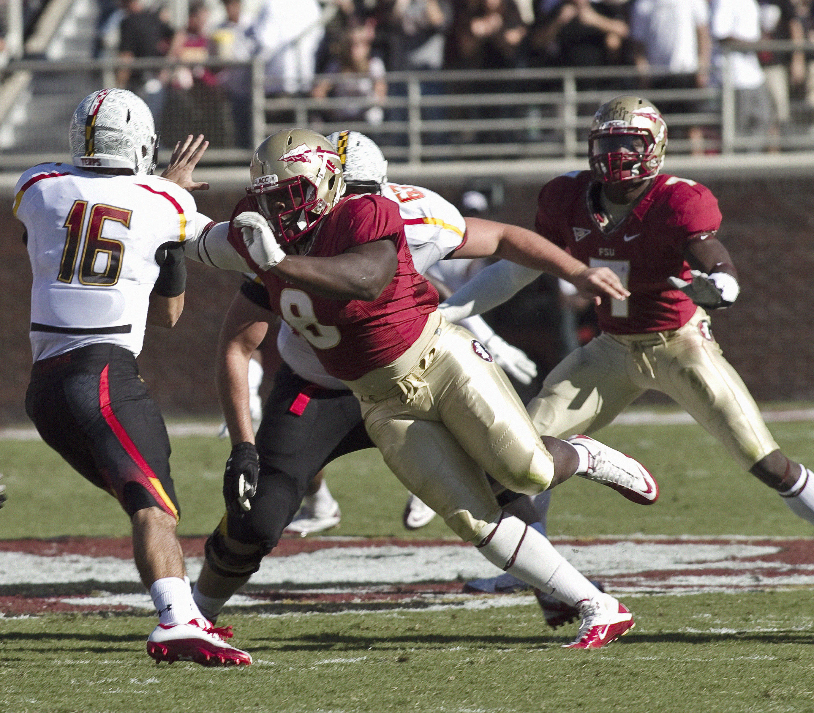 Tim Jernigan (8) with a big defensive rush. FSU vs Maryland 10/22/1111