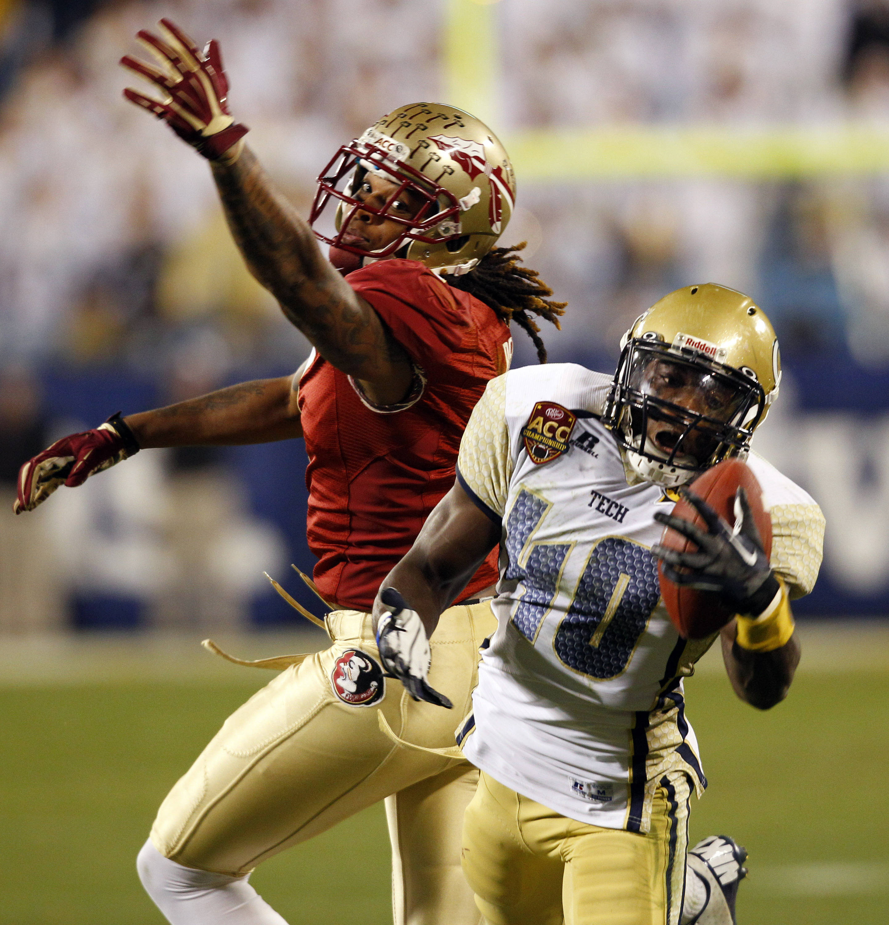Georgia Tech's Jemea Thomas (40) intercepts a pass intended for Florida State's Kelvin Benjamin during the second half of the Atlantic Coast Conference championship NCAA college football game in Charlotte, N.C., Saturday, Dec. 1, 2012. Florida State won 21-15. (AP Photo/Chuck Burton)
