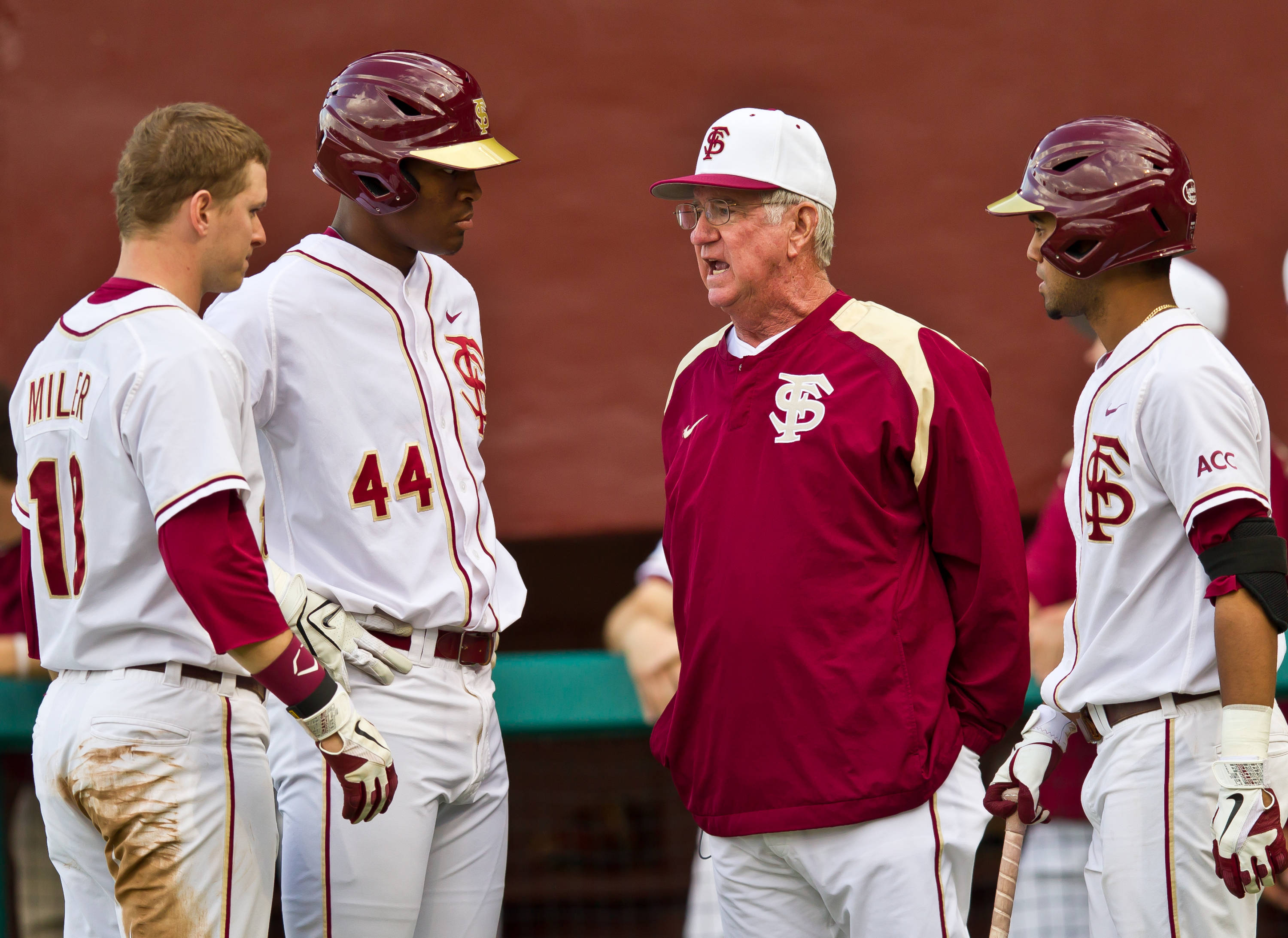 Head coach Mike Martin meets with the players during a mound visit by PC.