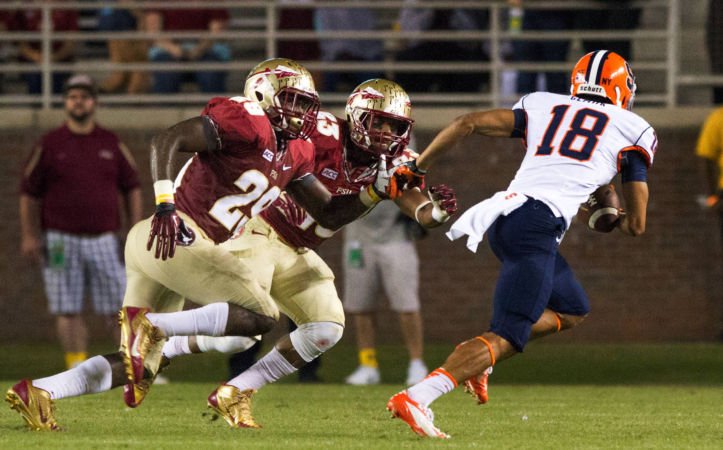 Nate Andrews (29) and Gerald Demps (23) take down a Syracuse ball carrier during FSU Football's 59-3 win over Syracuse on Saturday, November 16, 2013 in Tallahassee, Fla. Photo by Mike Schwarz.