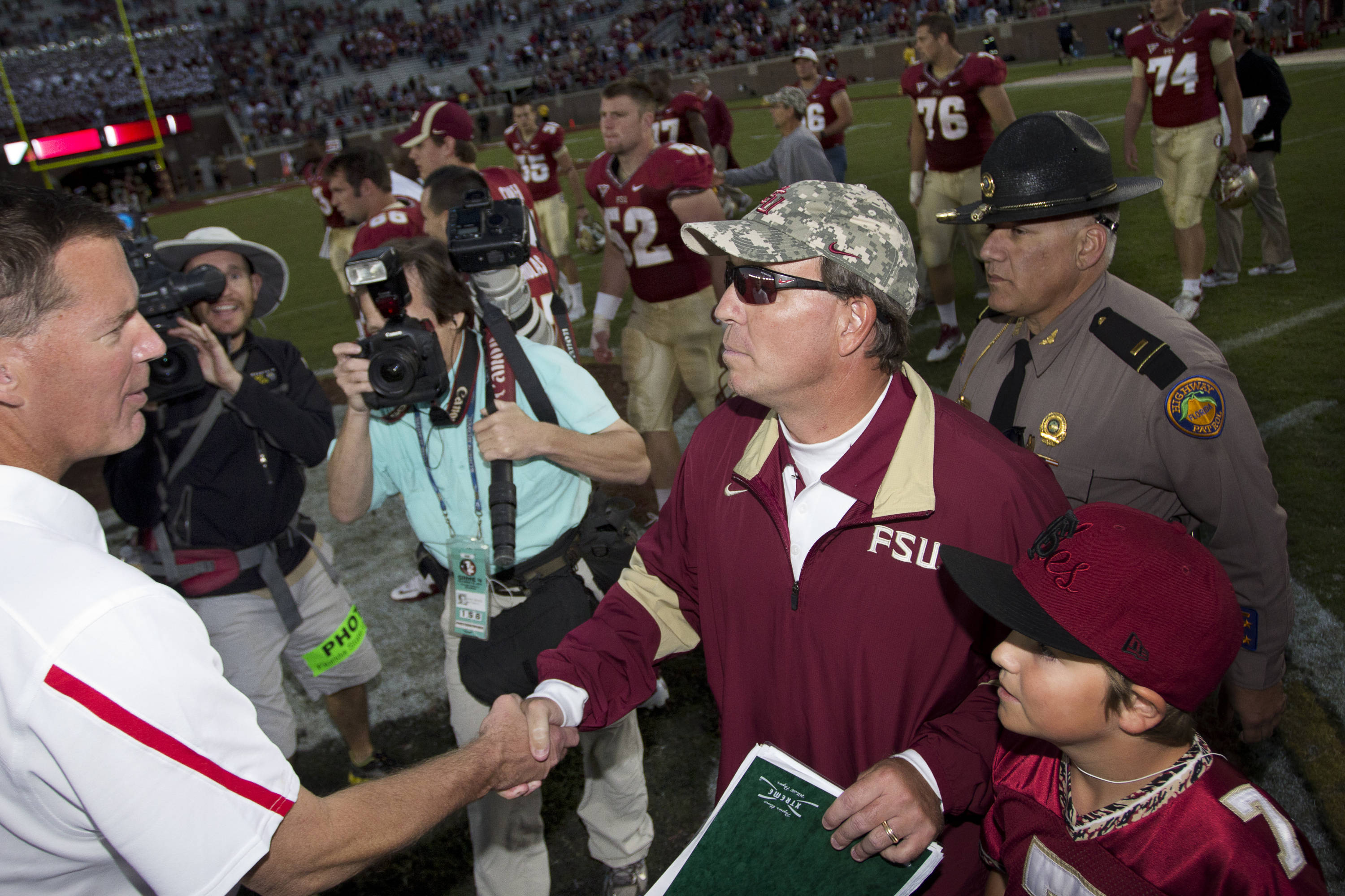 Jimbo Fisher shakes hands with Maryland's head coach after win against Maryland in Tallahassee, Florida on October 22, 2011.