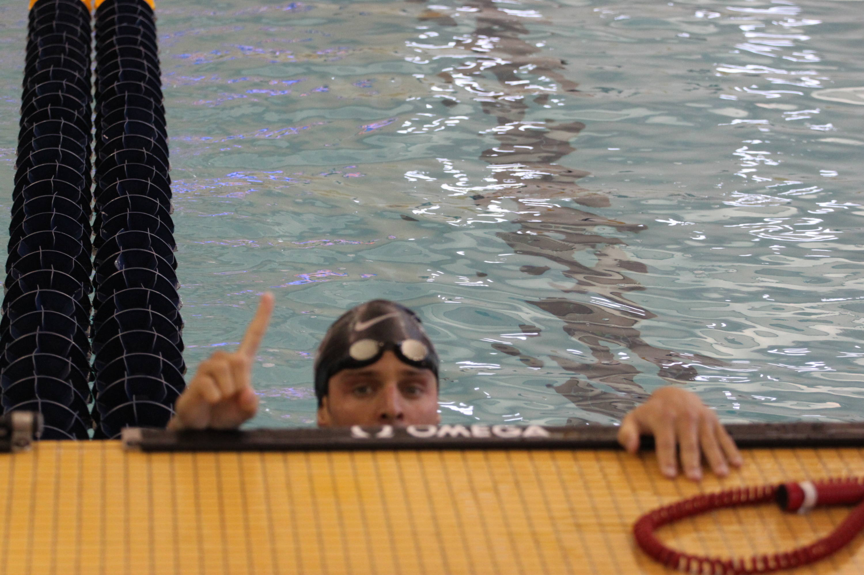 Robby Hayes celebrates breaking the school record in the 200 IM