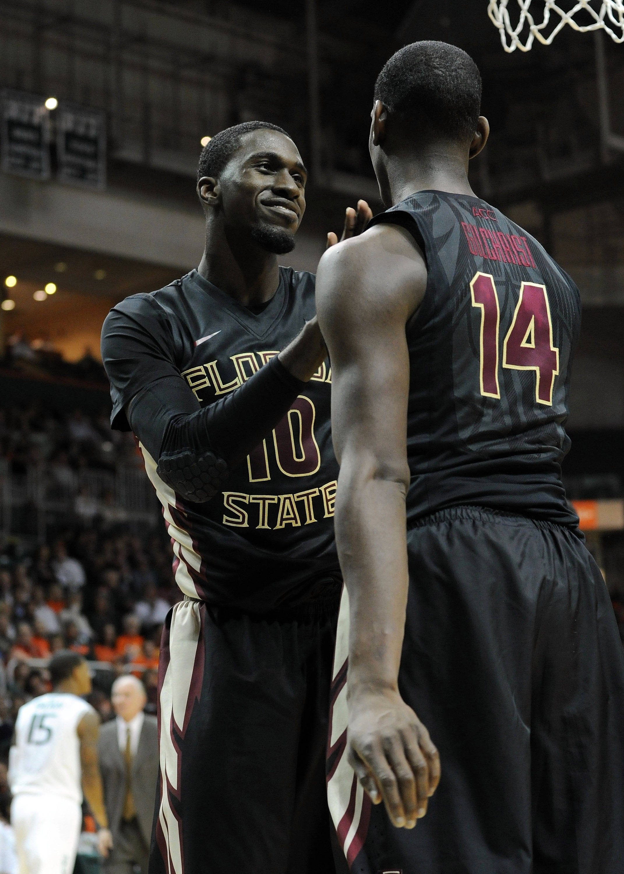 Jan 15, 2014; Coral Gables, FL, USA; Seminoles forward Okaro White (left) greets forward Robert Gilchrist (right) during the second half. Steve Mitchell-USA TODAY Sports