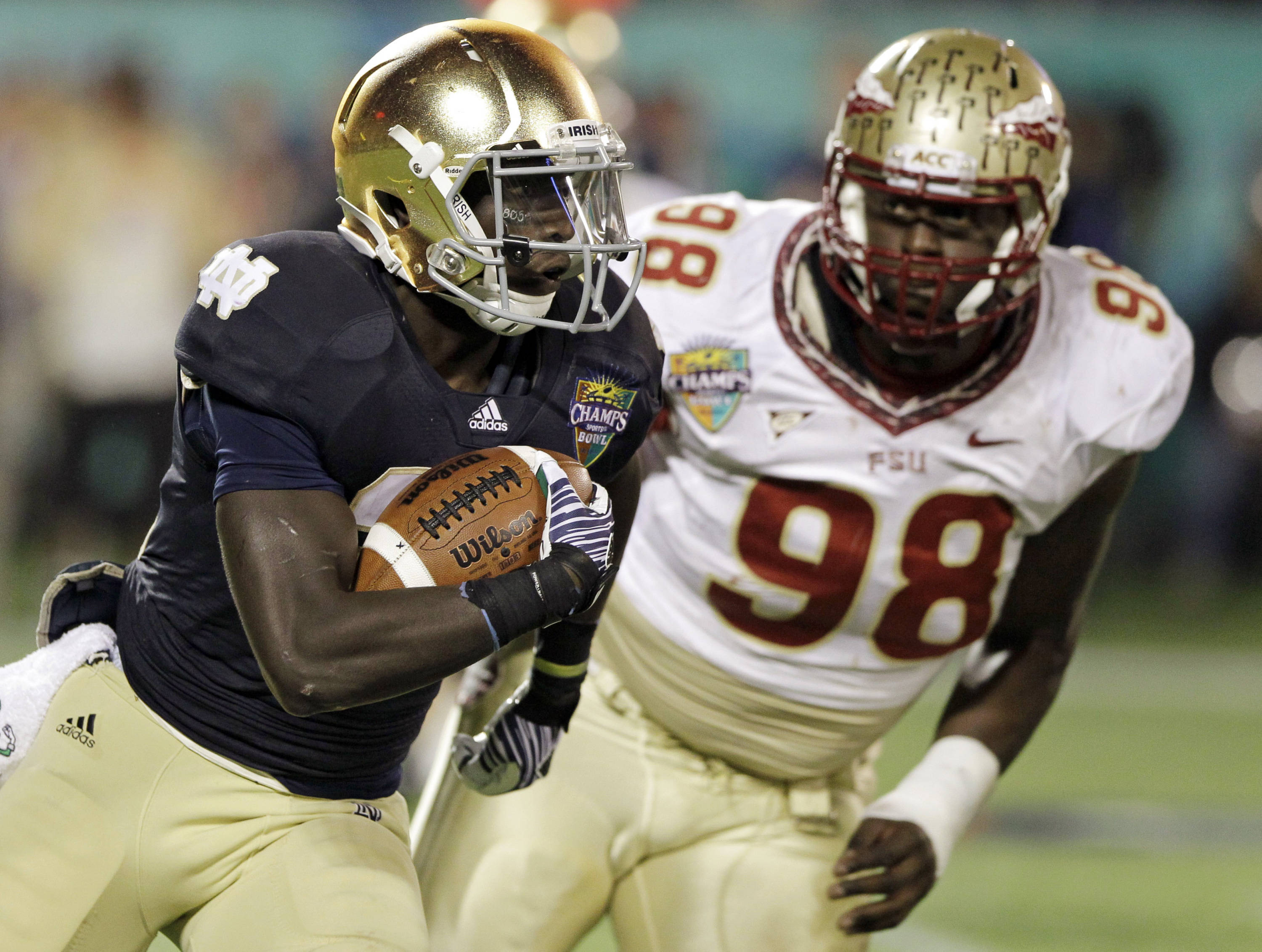 Notre Dame running back Cierre Wood, left, runs to get by Florida State defensive tackle Cameron Erving during the second half. (AP Photo/John Raoux)