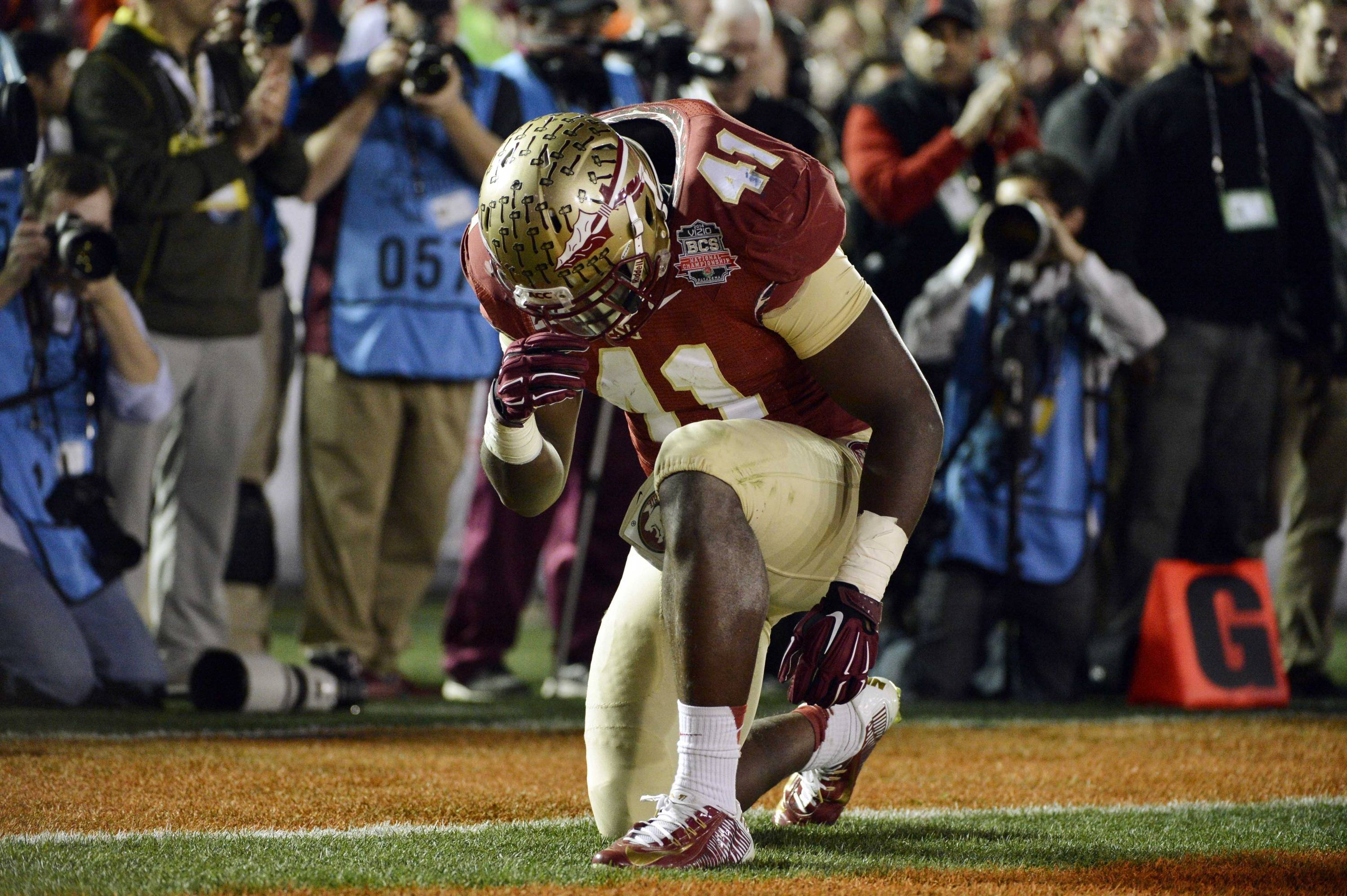 Jan 6, 2014; Pasadena, CA, USA; Florida State Seminoles fullback Chad Abram (41) reacts after scoring a touchdown against the Auburn Tigers during the second half of the 2014 BCS National Championship game at the Rose Bowl.  Mandatory Credit: Robert Hanashiro-USA TODAY Sports