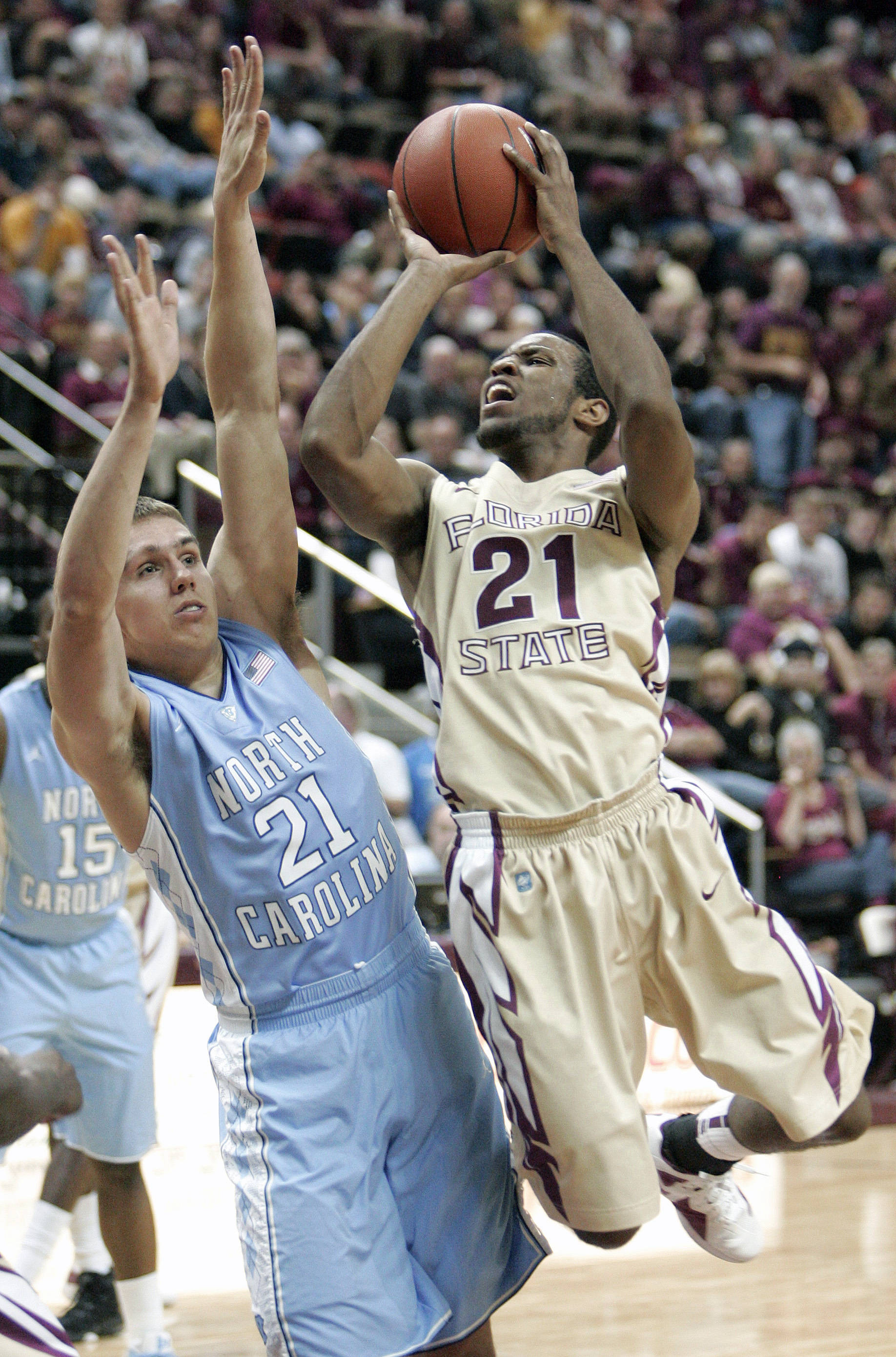 Florida State's Michael Snaer gets a shot off past the defense of North Carolina's Jackson Simmons during the second half of an NCAA college basketball game, Saturday, Jan. 14, 2012 in Tallahassee, Fla.(AP Photo/Steve Cannon)