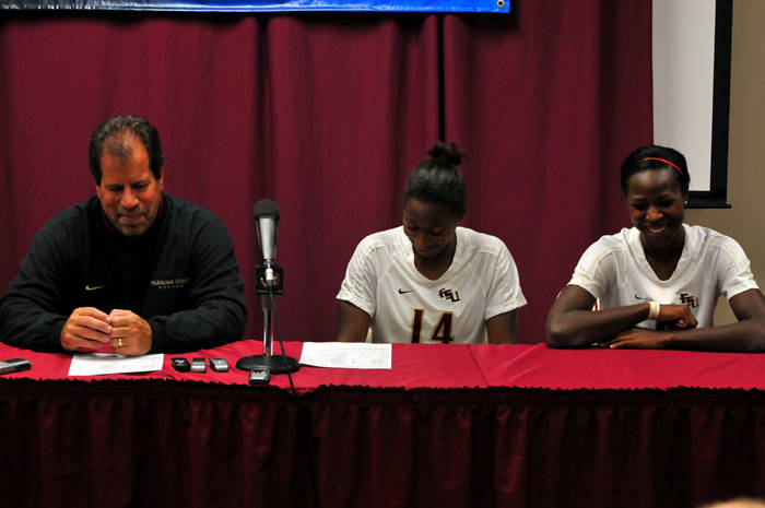 Head coach Mark Krikorian with Tiffany McCarty and Jessica Price in the postgame media room.