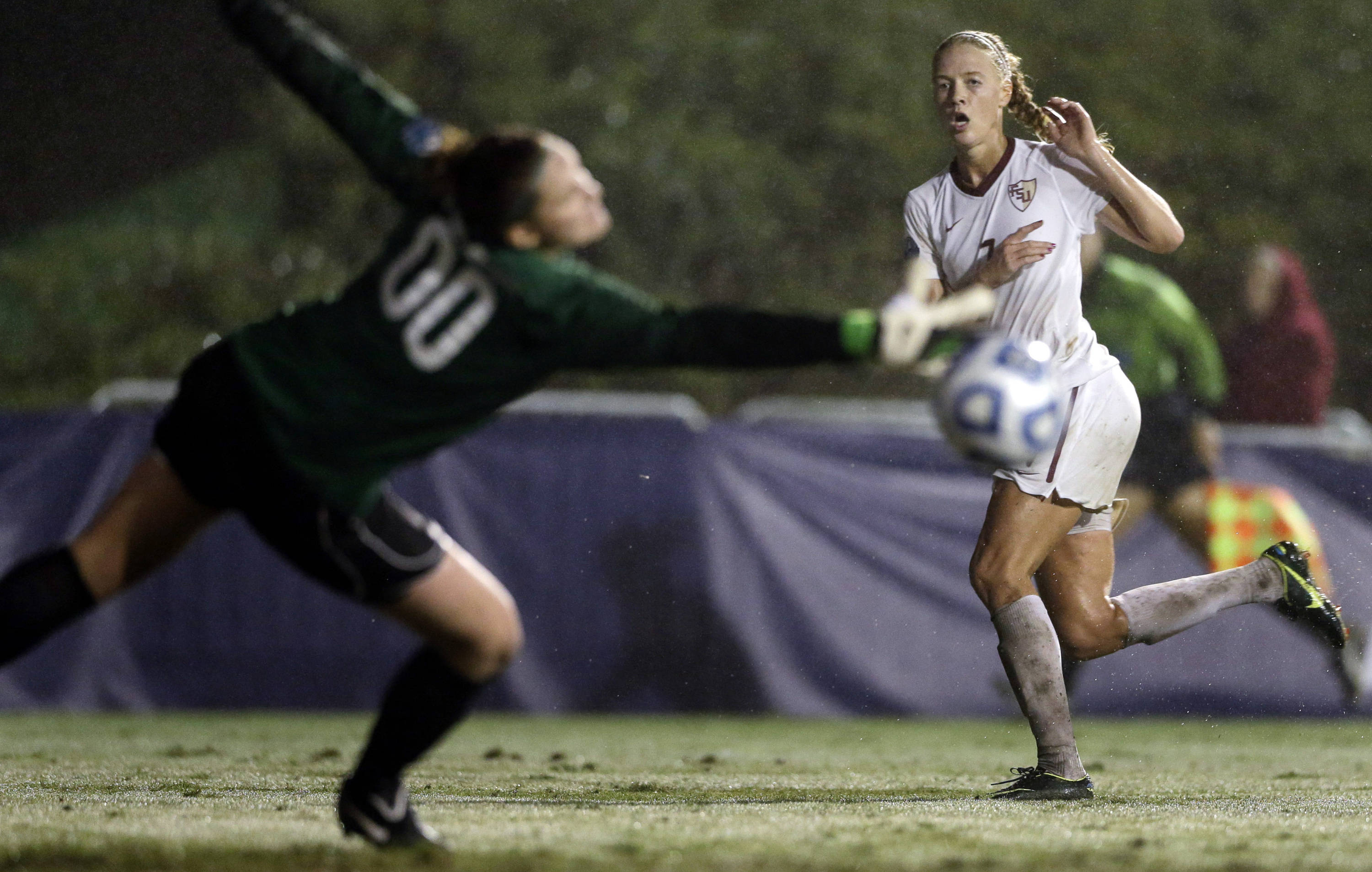 Dagny Brynjarsdottir watches her shot go wide of Penn State goalkeeper Erin McNulty during the second half. (AP Photo/Gregory Bull)