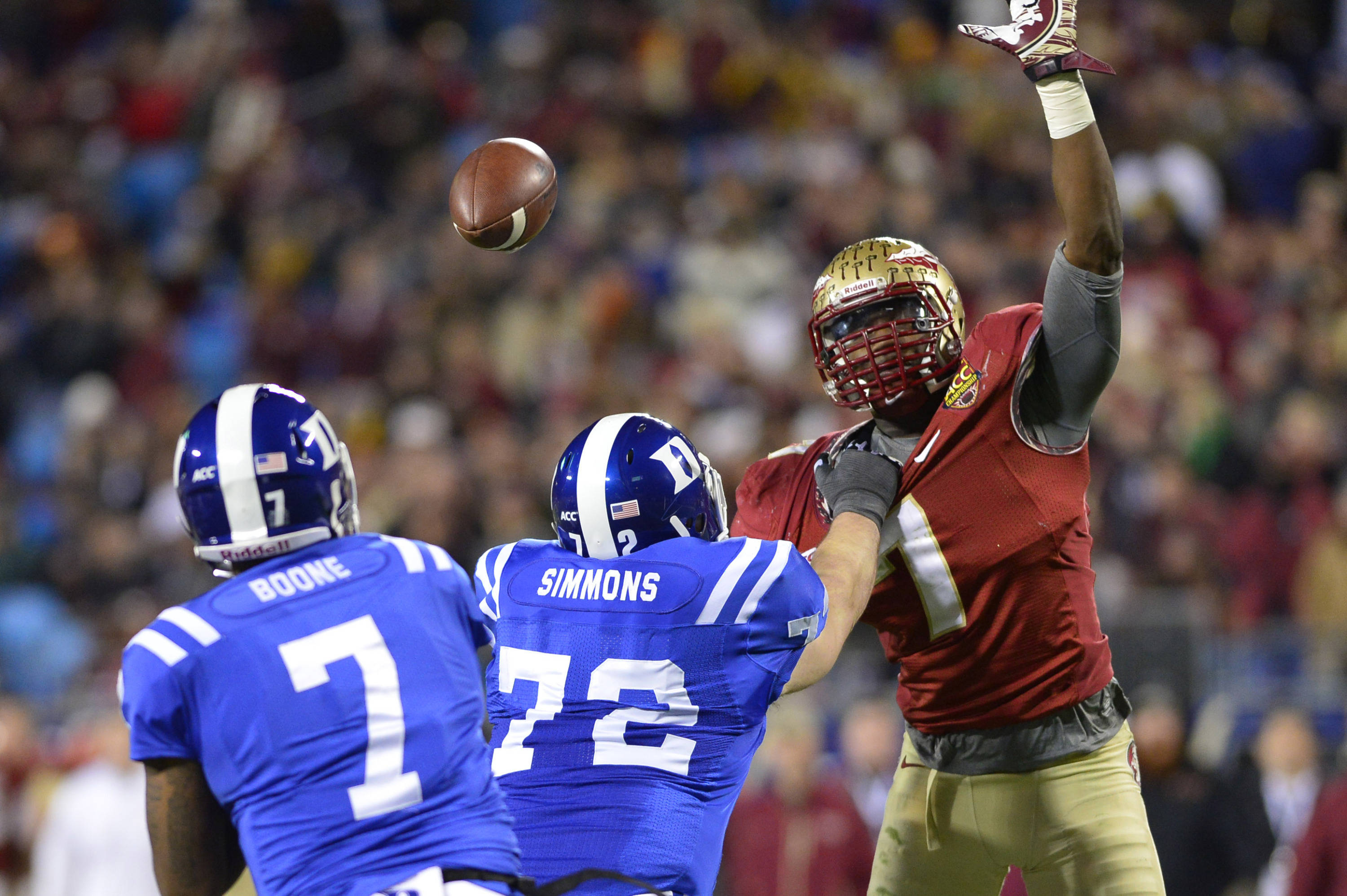 Dec 7, 2013; Charlotte, NC, USA; Duke Blue Devils quarterback Anthony Boone (7) passes the ball as offensive tackle Perry Simmons (72) blocks and Florida State Seminoles linebacker Christian Jones (7) pressures in the third quarter at Bank of America Stadium. Mandatory Credit: Bob Donnan-USA TODAY Sports