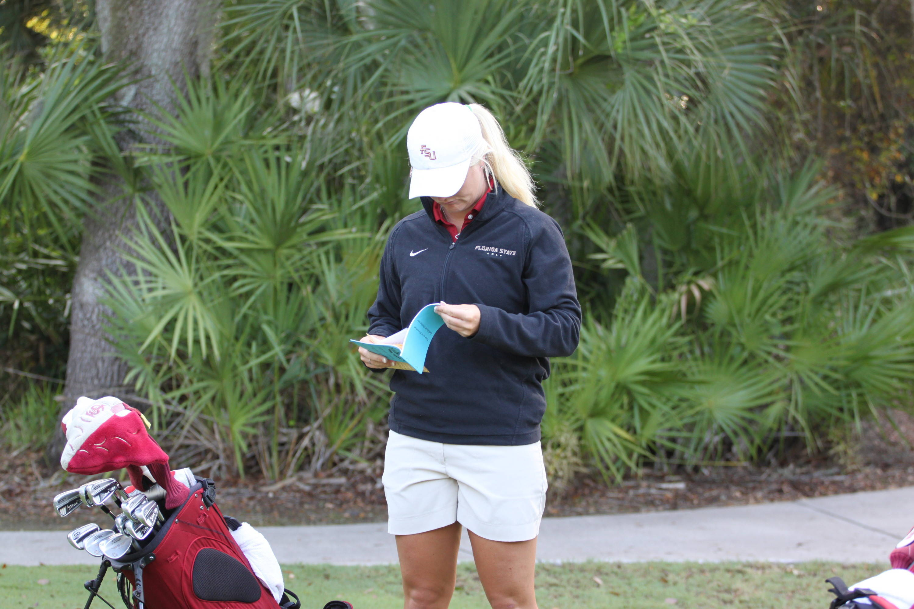 2011 NCAA Golf -- Hannah Thomson studies his yardage book in preparation for her round,