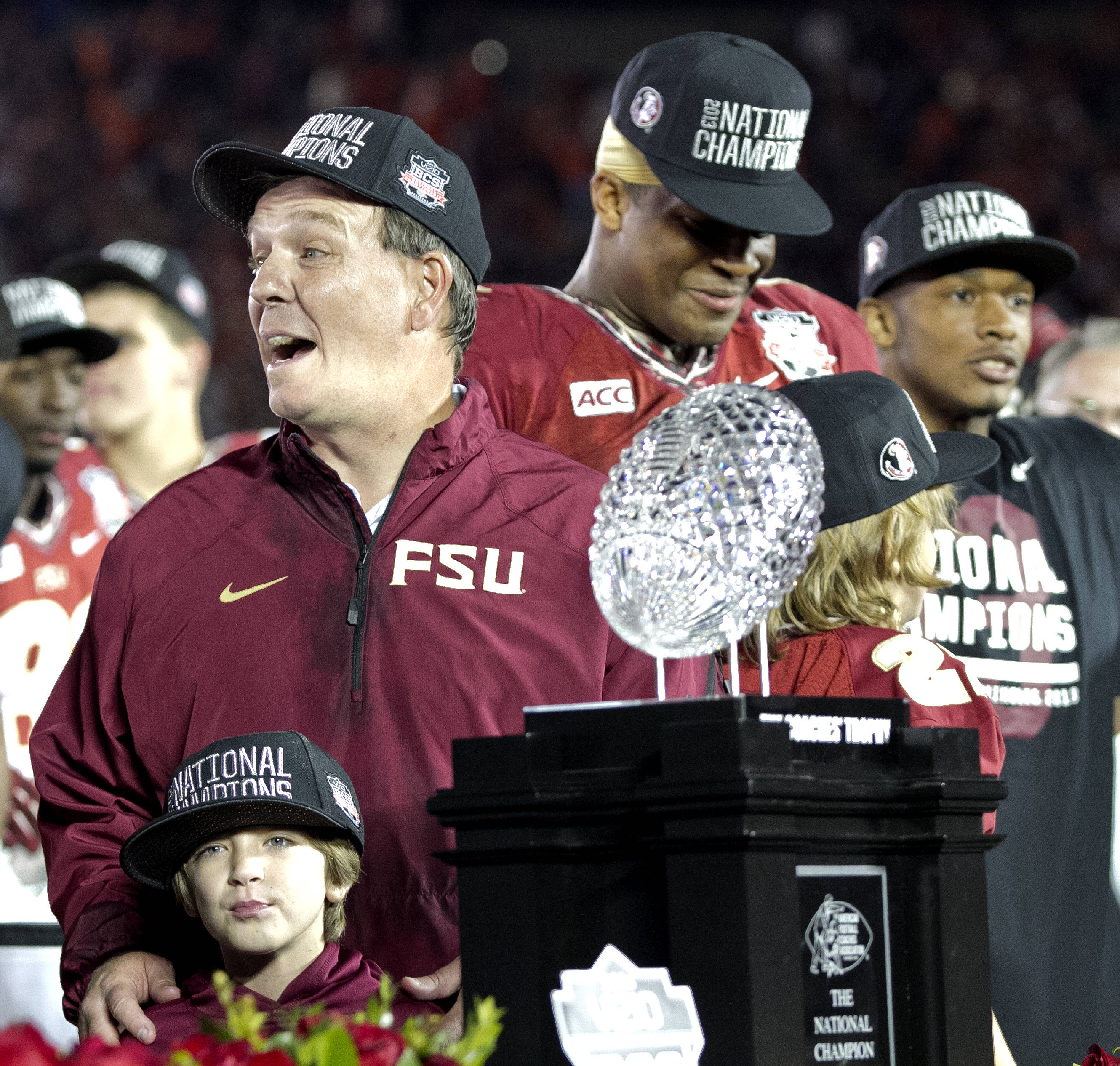 Head Coach Jimbo Fisher and son Ethan enjoy the moment together before accepting the championship trophy, BCS Championship, FSU vs Auburn, Rose Bowl, Pasadena, CA,  1-06-14,  (Photo by Steve Musco)
