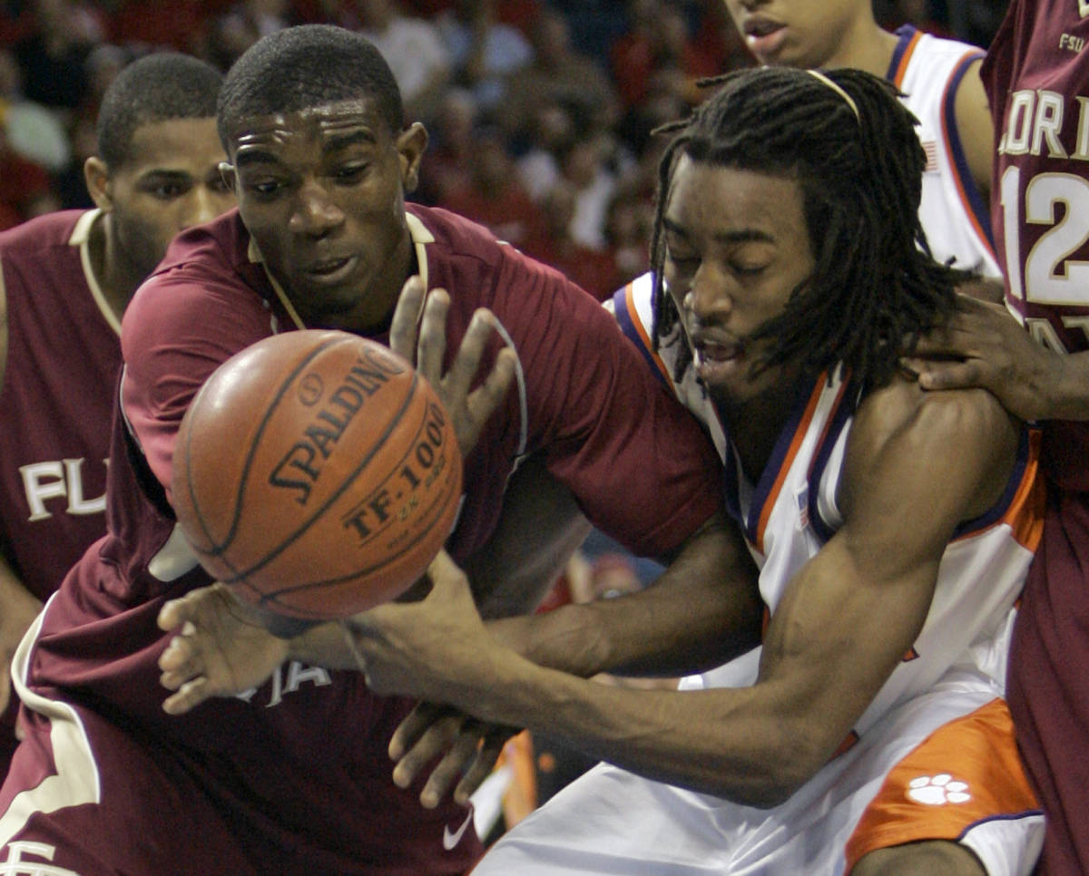 Florida State's Uche Echefu, left, and Clemson's Raymond Sykes battle for a loose ball during the first half of a first round game of the Men's Atlantic Coast Conference basketball tournament in Tampa, Fla., Thursday, March 8, 2007. (AP Photo/John Raoux)