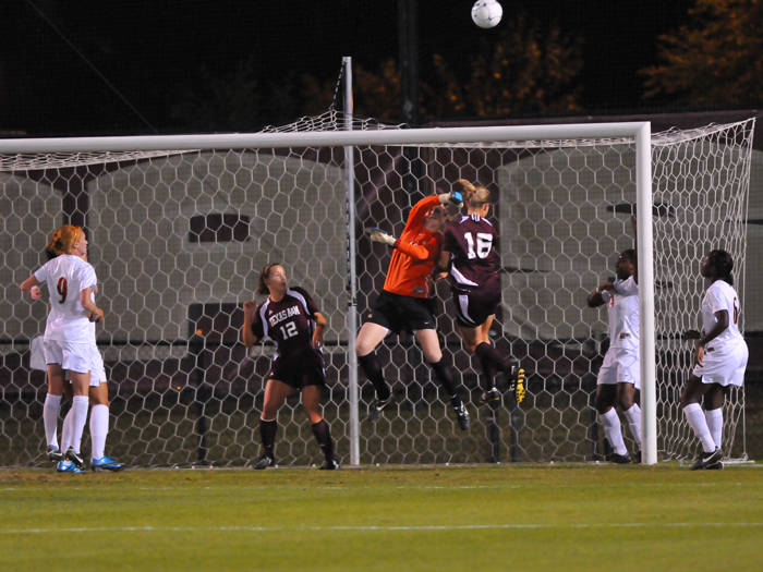 Erin McNulty punches away the ball on an Aggie corner