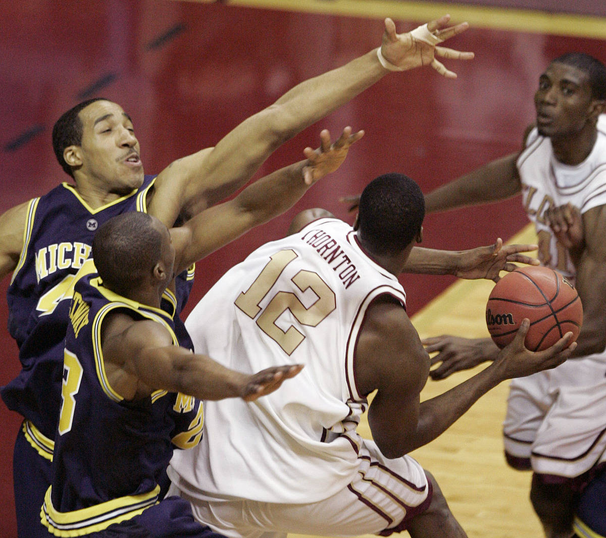 Florida State's Al Thornton is defended by Michigan's Courtney Sims and Brent Petway. (AP Photo/Steve Cannon)