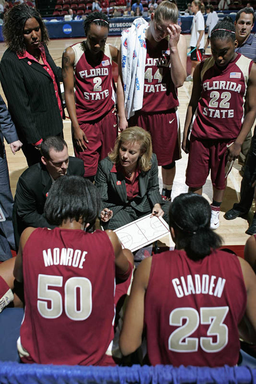 Coach Sue goes over a play with her team.