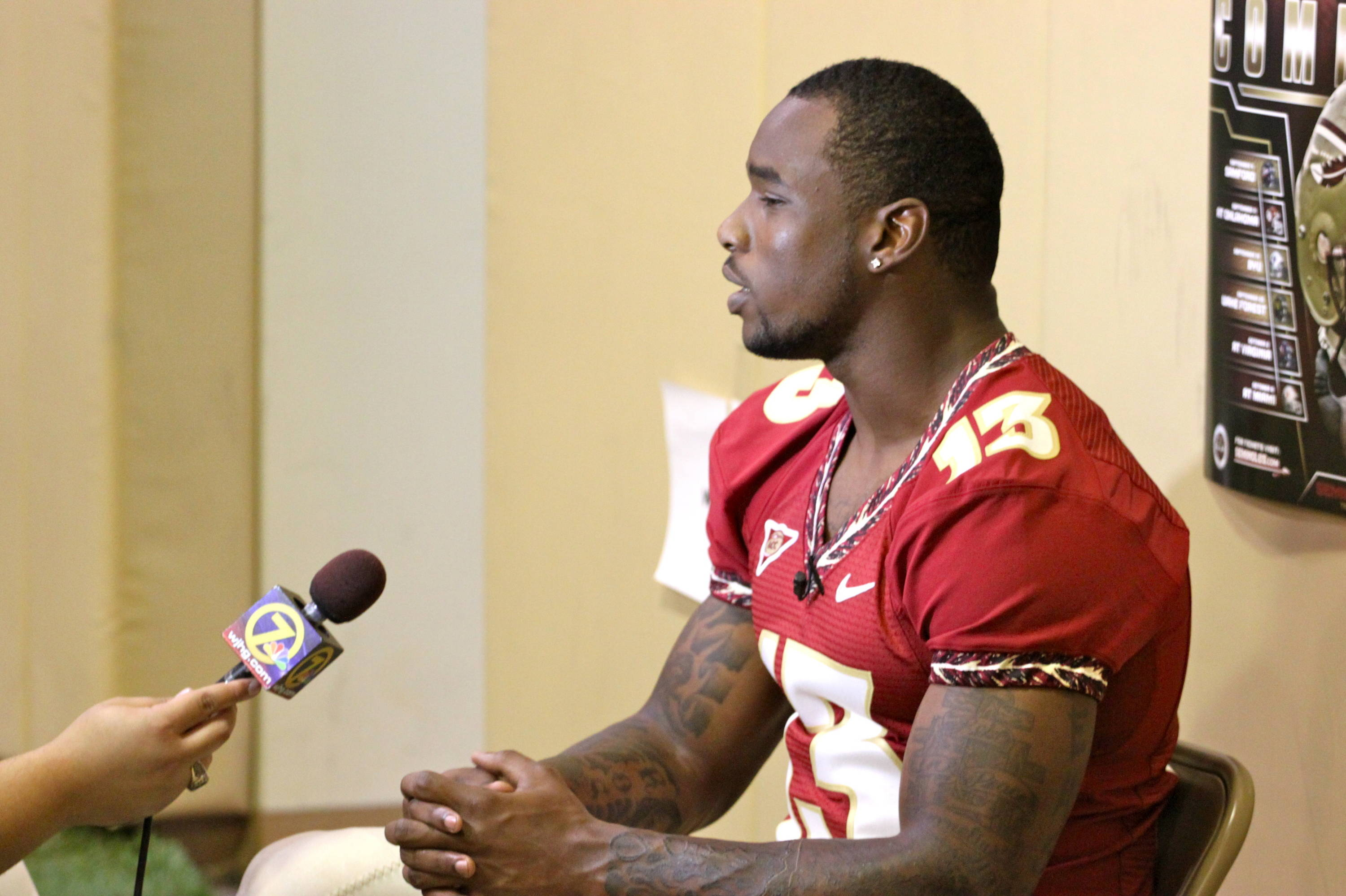Nigel Bradham speaks with the electronic media during football media day.
