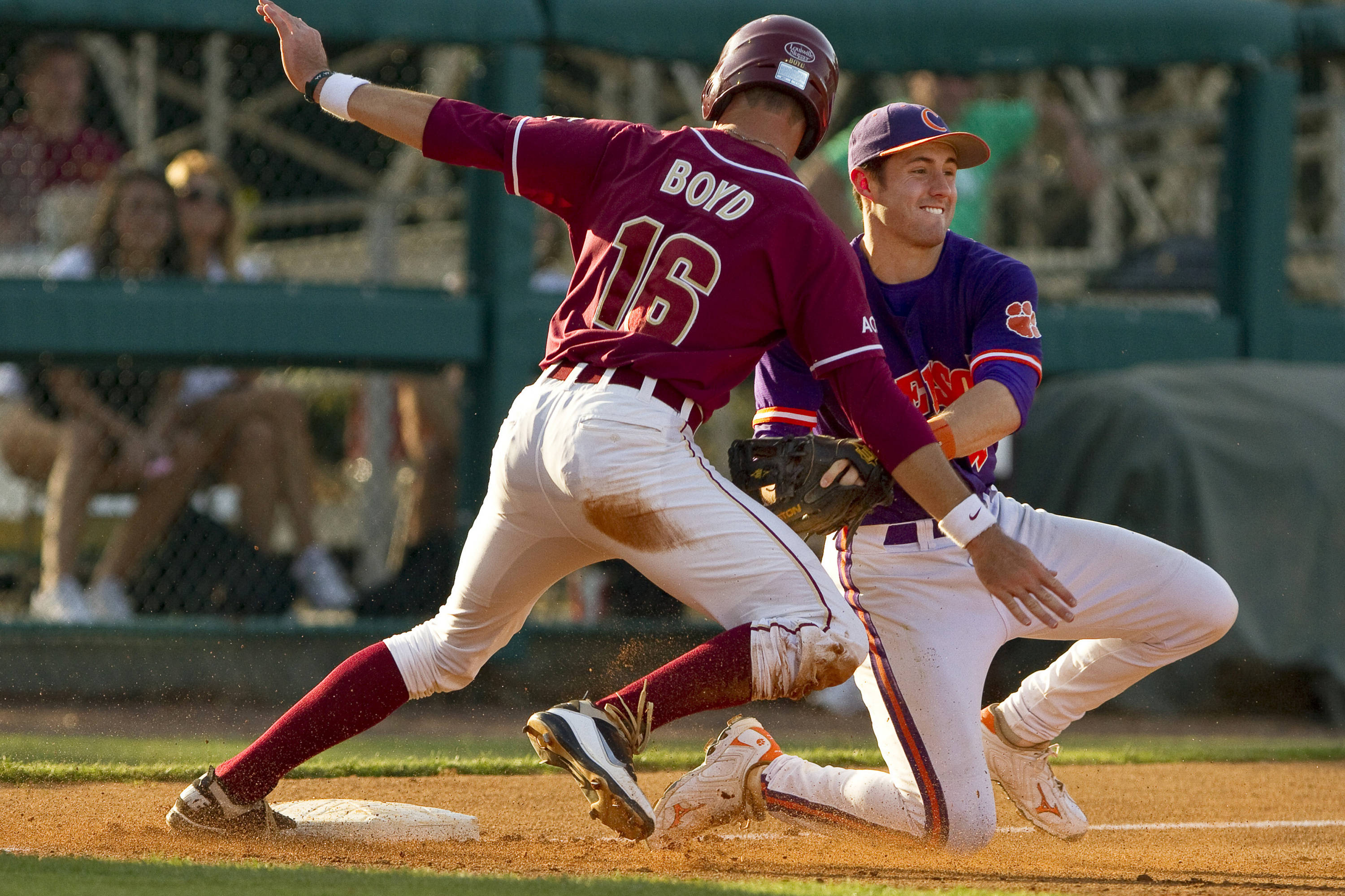 Jayce Boyd (16) attempts to avoid a tag from Clemson's third baseman.