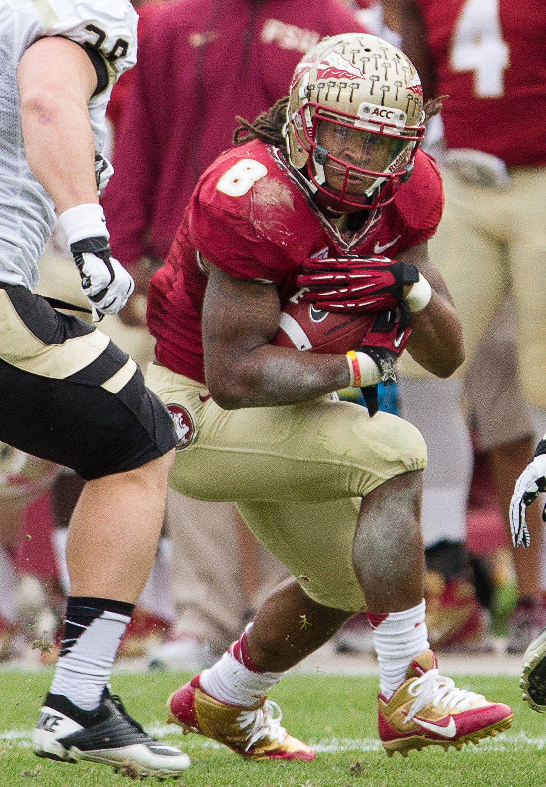 Devonta Freeman (8) protects the ball during FSU Football's 80-14 victory over Idaho in Tallahassee, Fla on Saturday, November 23, 2013. Photos by Mike Schwarz.