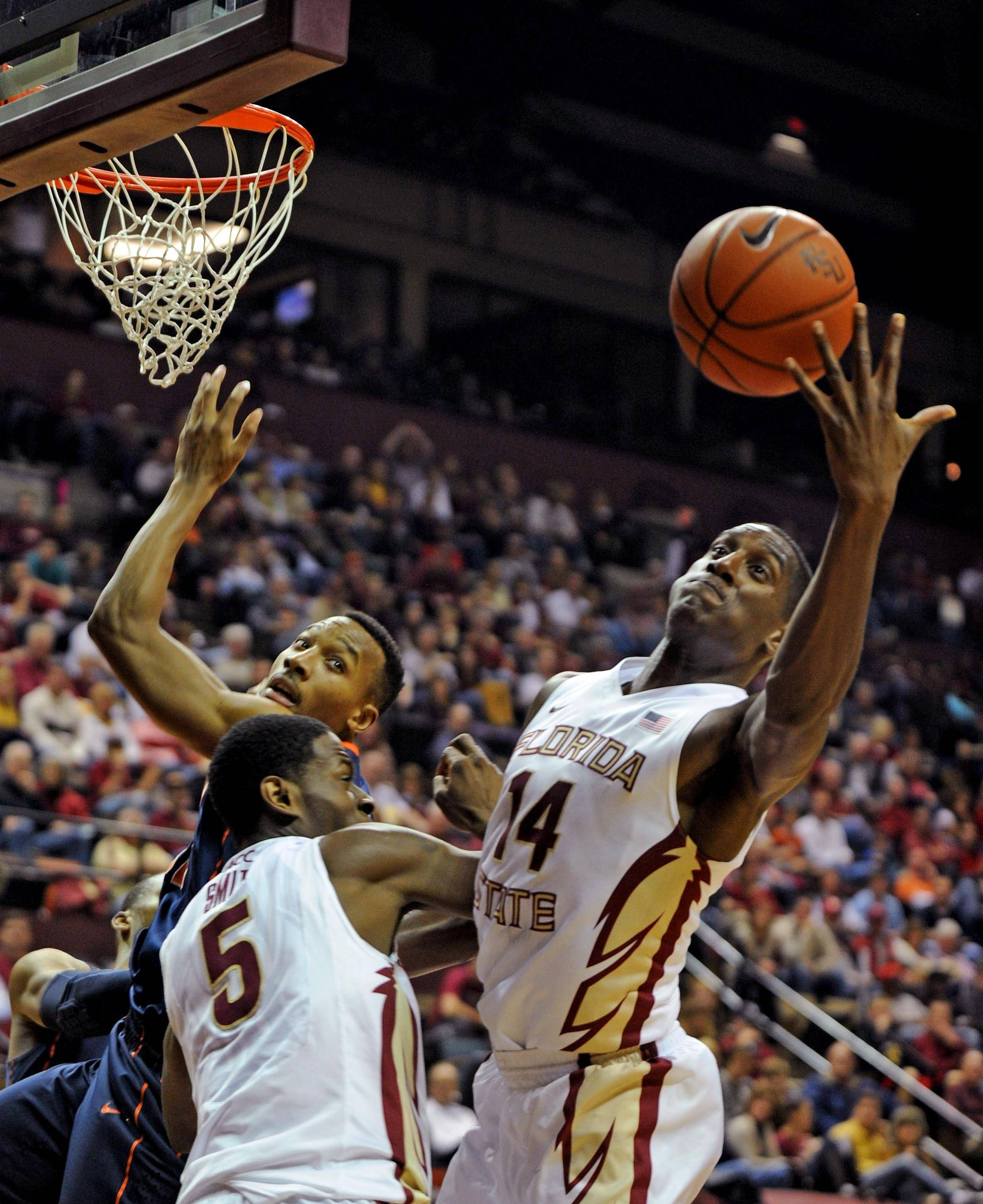 Jan 4, 2014; Tallahassee, FL, USA; Seminoles forward Robert Gilchrist (14) reaches for a rebound during the first half. Melina Vastola-USA TODAY Sports