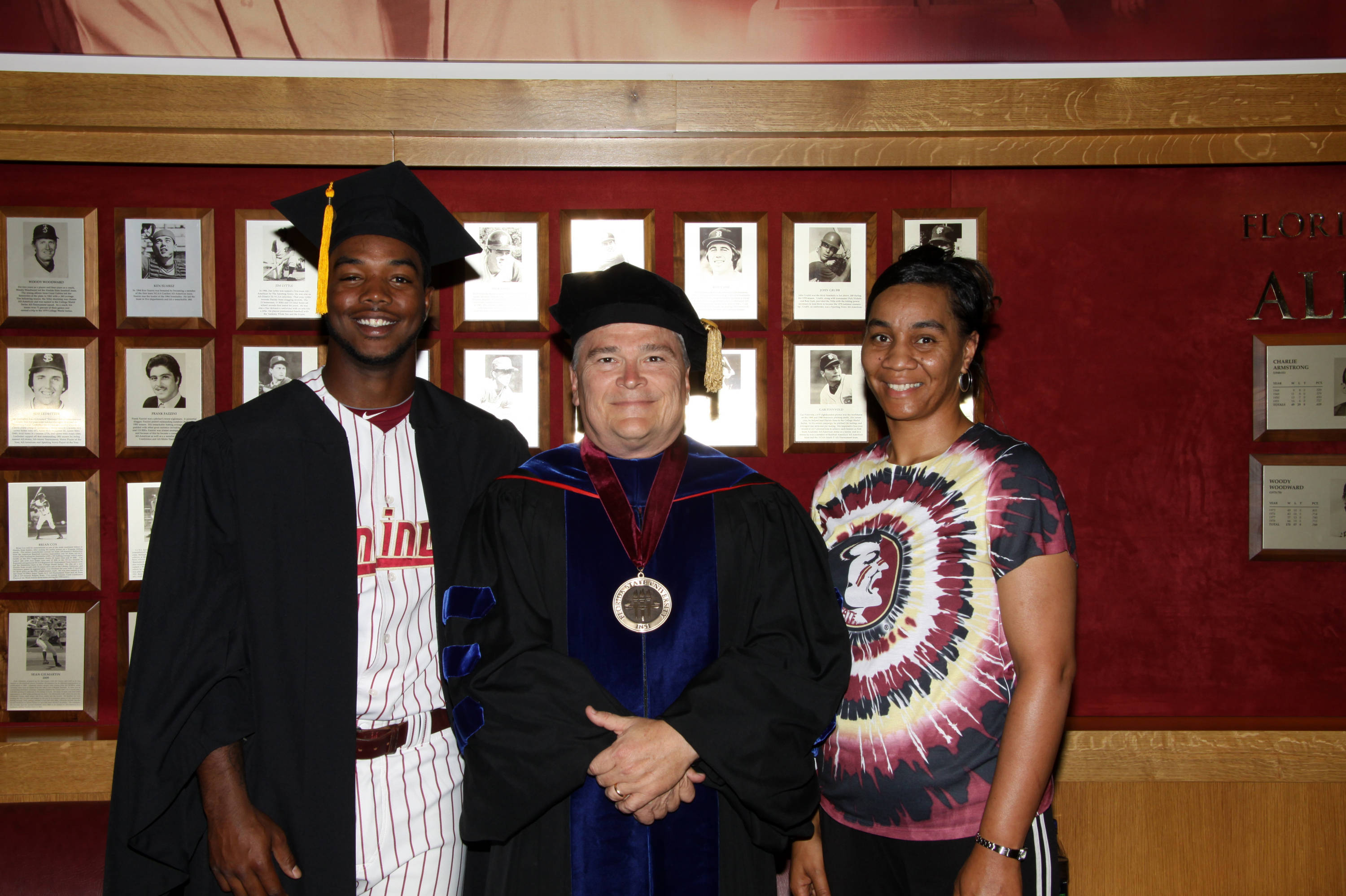2011 Spring Graduation Ceremony held at Dick Howser Stadium to honor the graduating baseball seniors. Taiwan Easterling (1) with his mother and President Barron