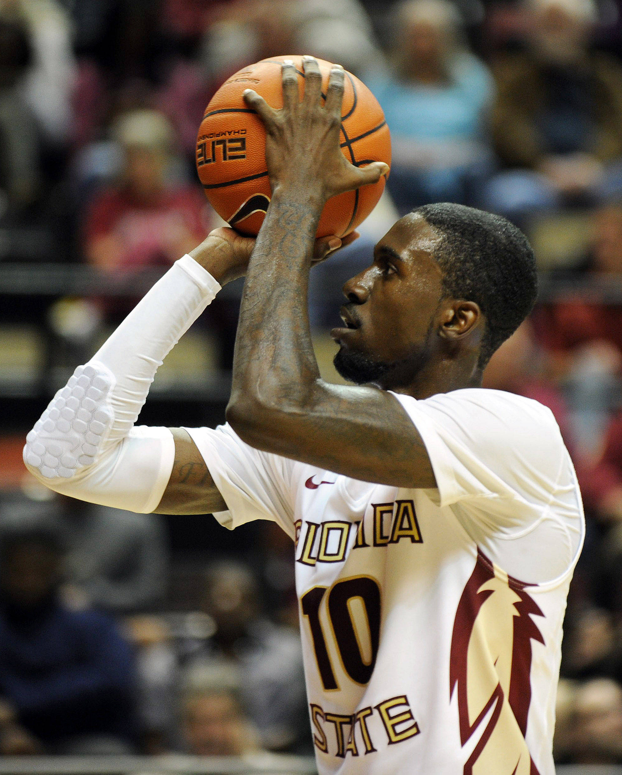 Nov 8, 2013; Tallahassee, FL, USA; Florida State Seminoles forward Okaro White (10) takes a free throw during the first half against the Jacksonville Dolphins at the Donald L. Tucker Center. Mandatory Credit: Melina Vastola-USA TODAY Sports