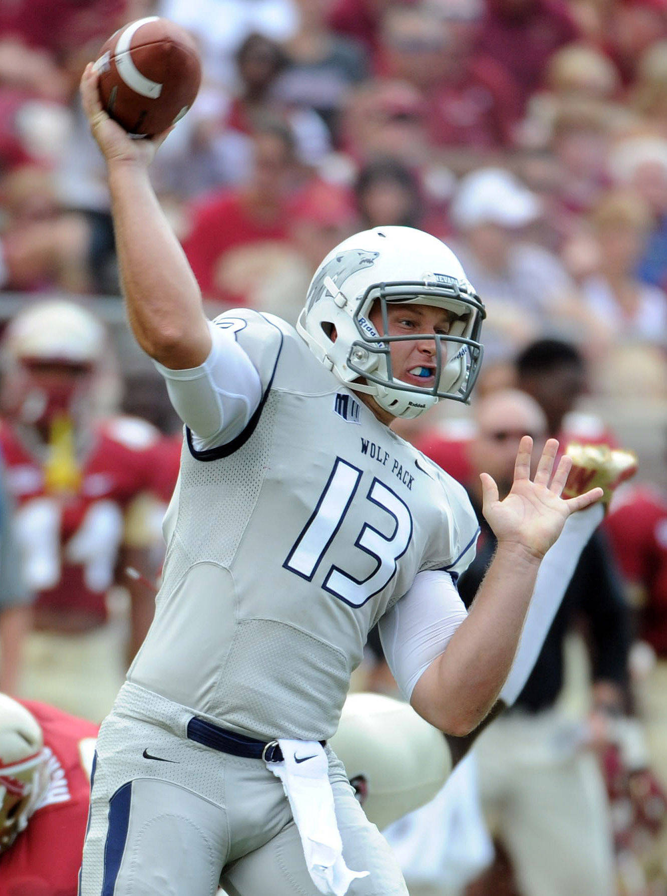 Sep 14, 2013; Tallahassee, FL, USA; Nevada Wolf Pack quarterback Devin Combs (13) throws the ball during the first half of the game against the Florida State Seminoles at Doak Campbell Stadium. Mandatory Credit: Melina Vastola-USA TODAY Sports
