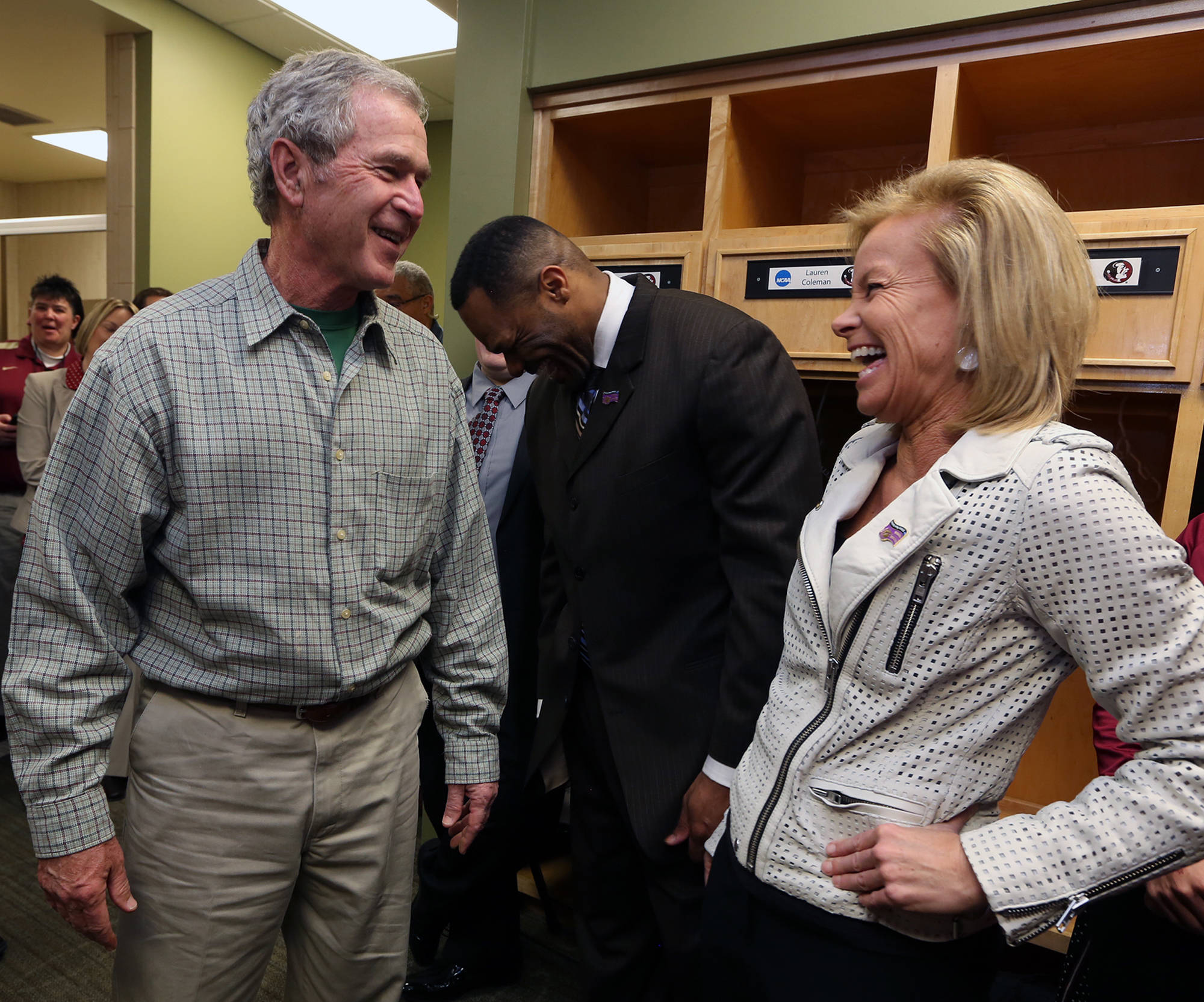 Former President George W. Bush laughs with Florida State University head women's coach Sue Semrau, right before their  NCAA college basketball game against Baylor, Tuesday, March,  26, 2013, in Waco, Texas. (AP Photo/Florida State University, Rod Aydelotte, Pool)