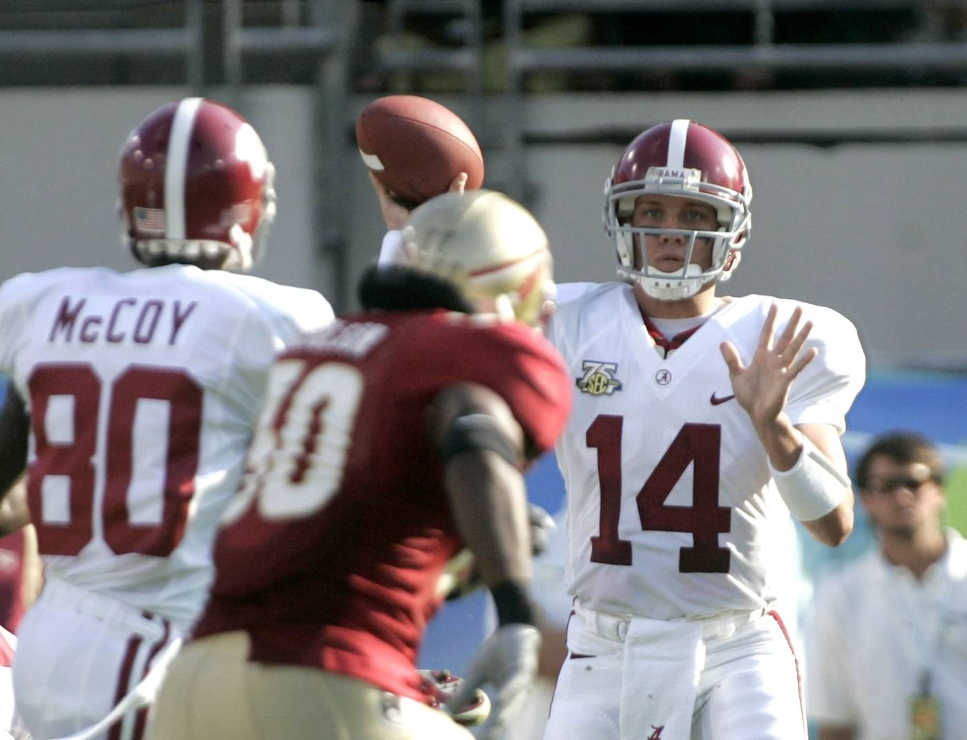 Alabama quarterback John Parker Wailson, right, throws a first-quarter pass to receiver Mike McCoy, left, as Florida State's Derek Nicholson, center, moves in on the play. (AP Photo/Phil Coale)