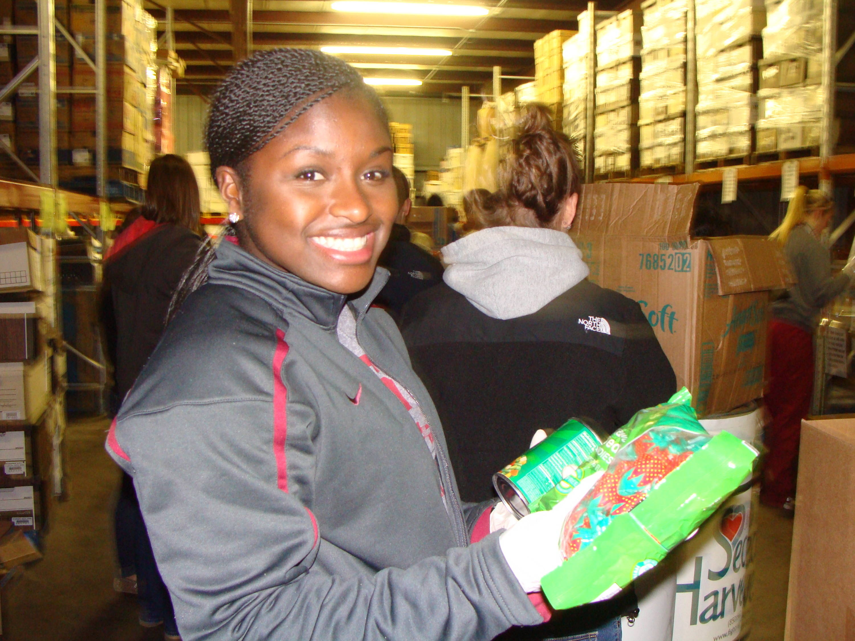 Morgan Bullock does her part for the Holiday Food Drive