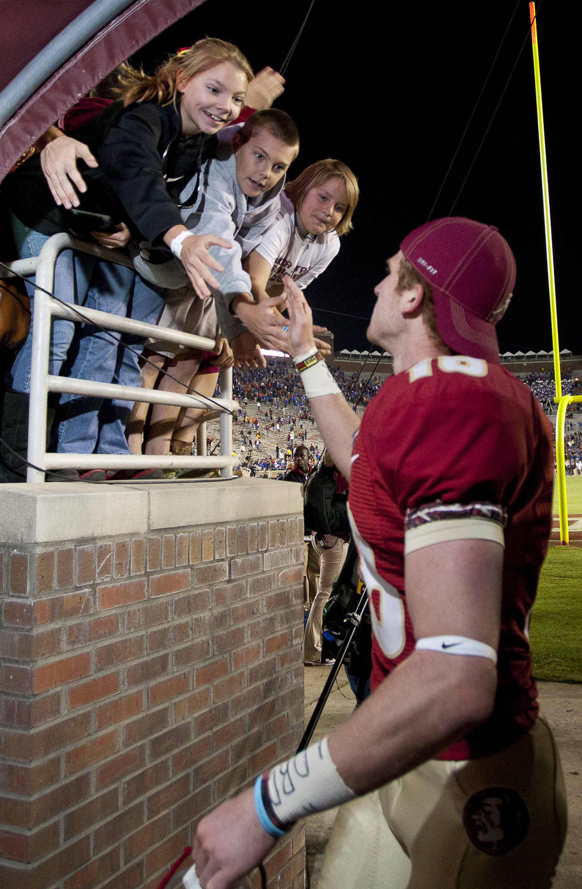 Fans greet Dustin Hopkins (18) after FSU Football's game against UF on Saturday, November 24, 2012 in Tallahassee, Fla.