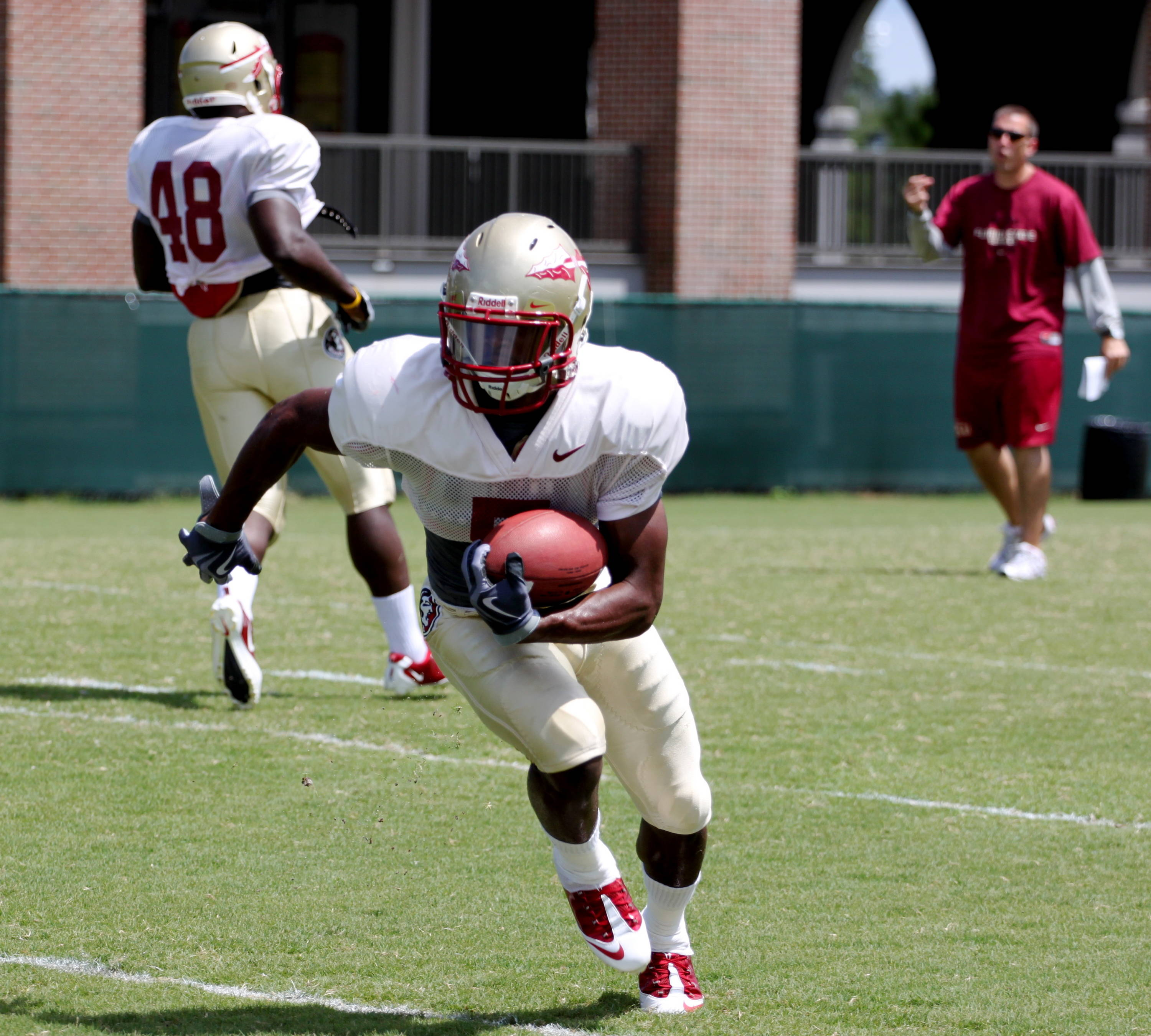 Greg Reid (5) with the ball during special teams drills