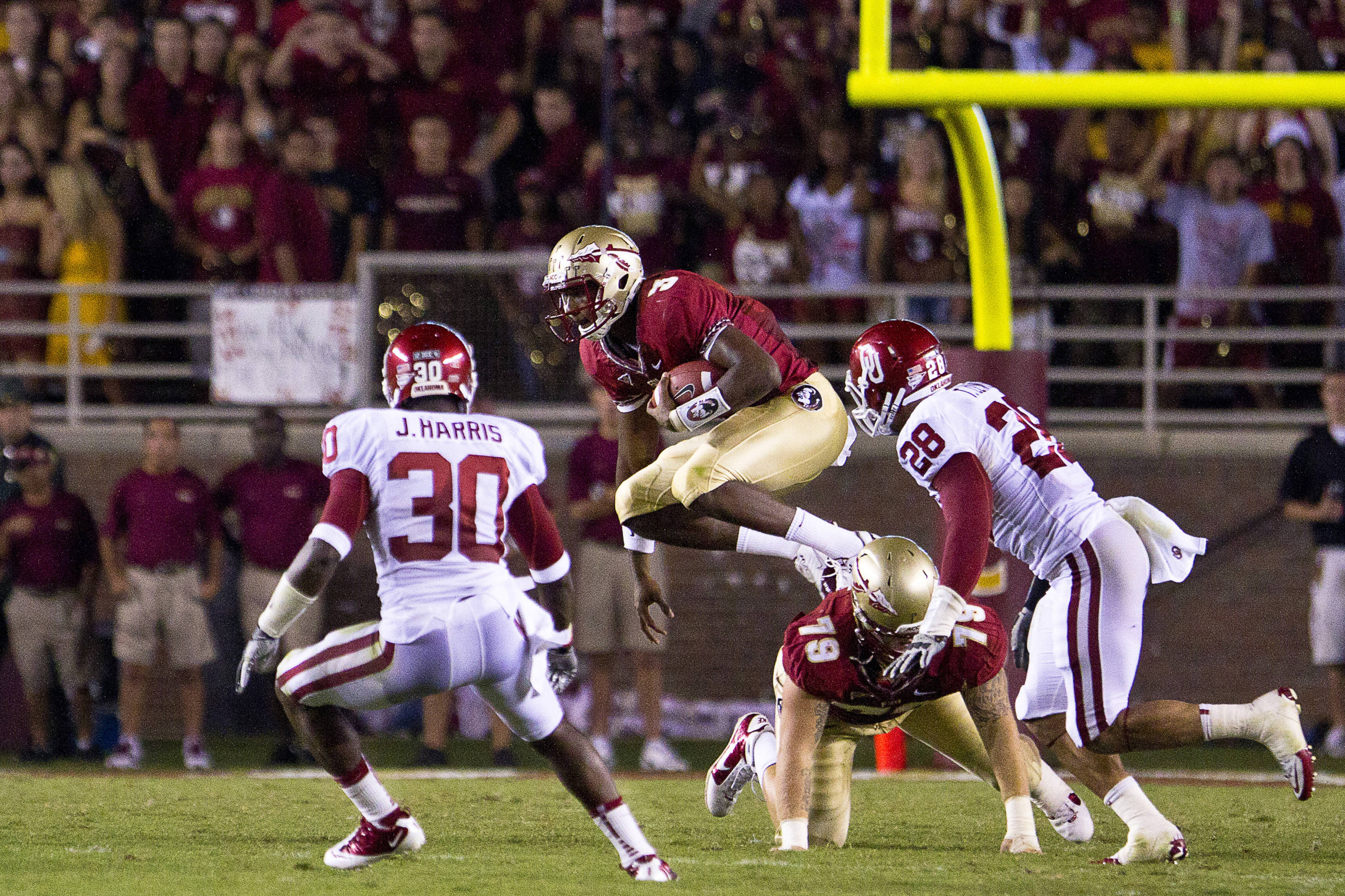 EJ Manuel (3) avoids defenders and a fallen teammate during the game against Oklahoma on September 17, 2011.