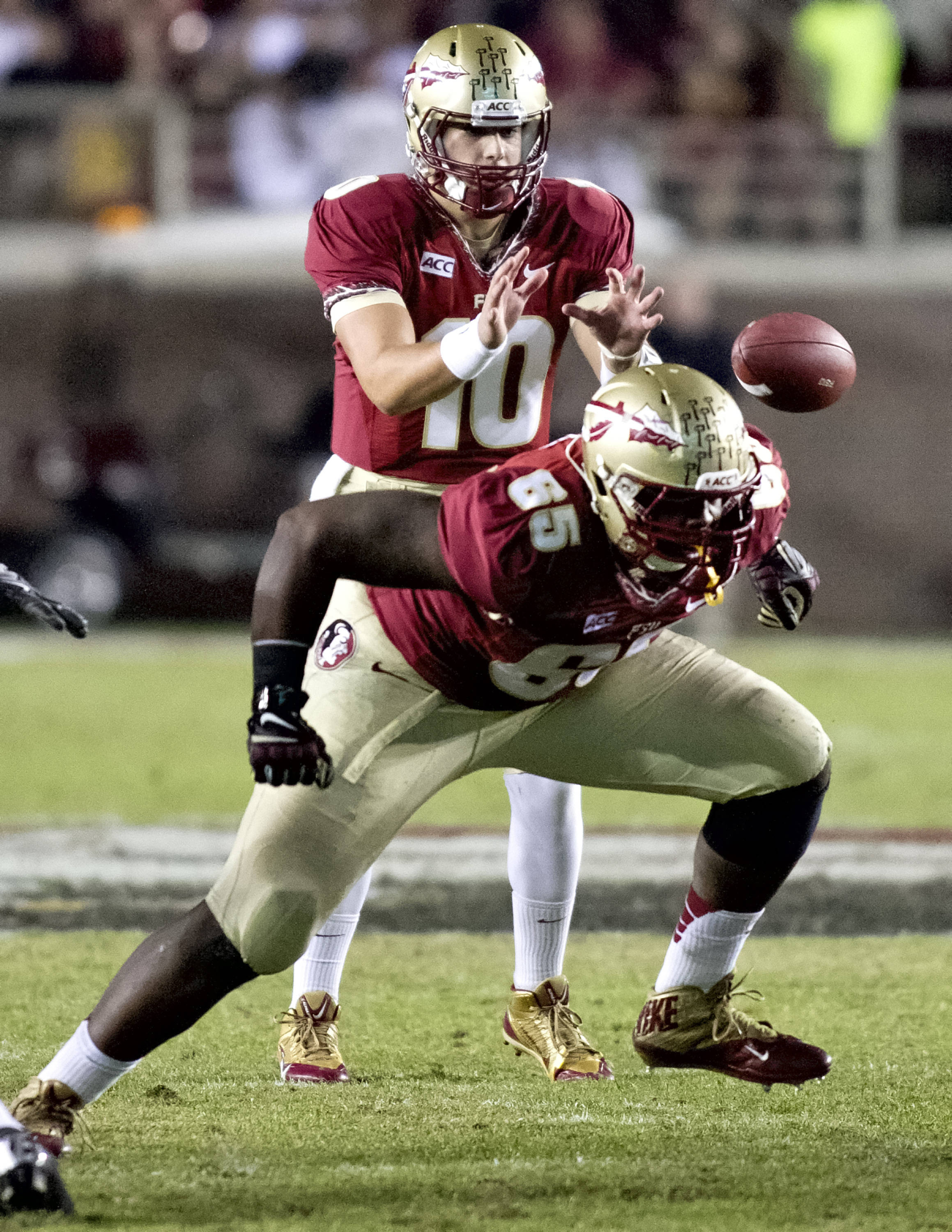 Sean Maguire (10), Ruben Carter (65), FSU vs Idaho, 11-23-13,  (Photo by Steve Musco)