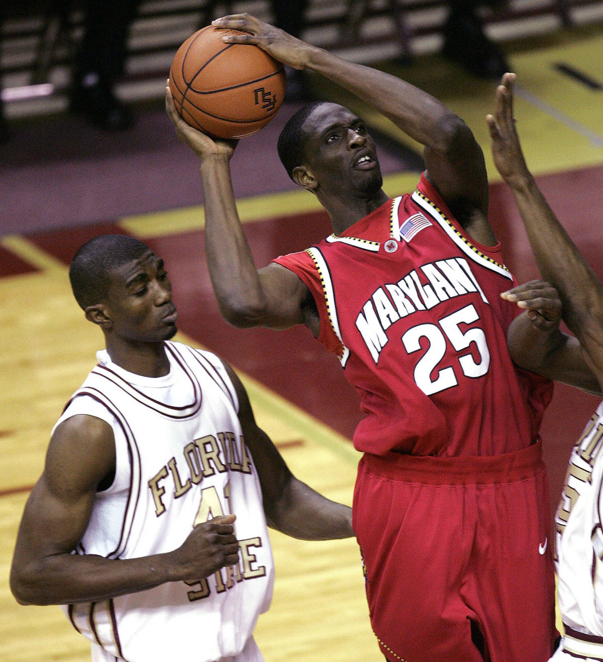 Maryland's Ekene Ibekwe, right, scores two first-half points as Florida State's Uche Eche Echefu, left, attempts to defend during a college basketball game, Tuesday, Jan. 30, 2007, in Tallahassee, Fla.(AP Photo/Phil Coale)