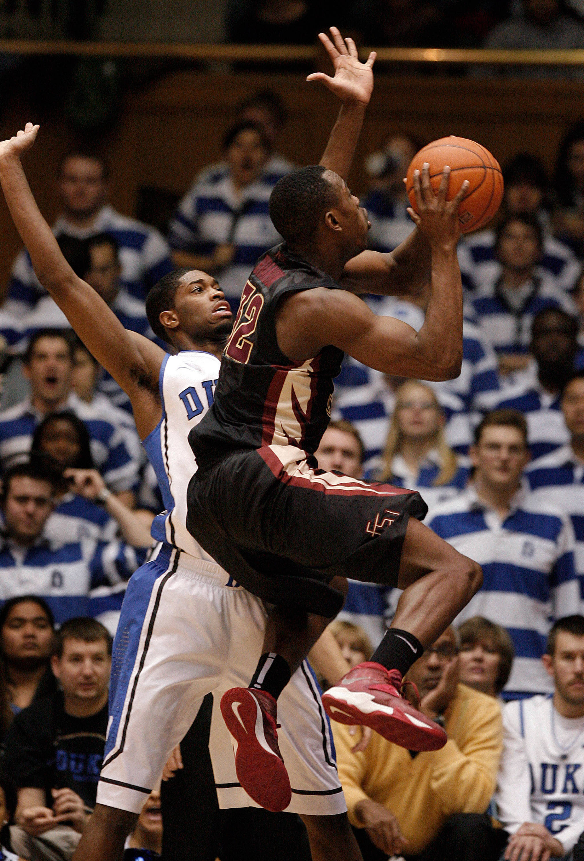 Jan 25, 2014; Durham, NC, USA; Seminoles guard Montay Brandon (32) drives against Duke Blue Devils forward Amile Jefferson (21). Mark Dolejs-USA TODAY Sports