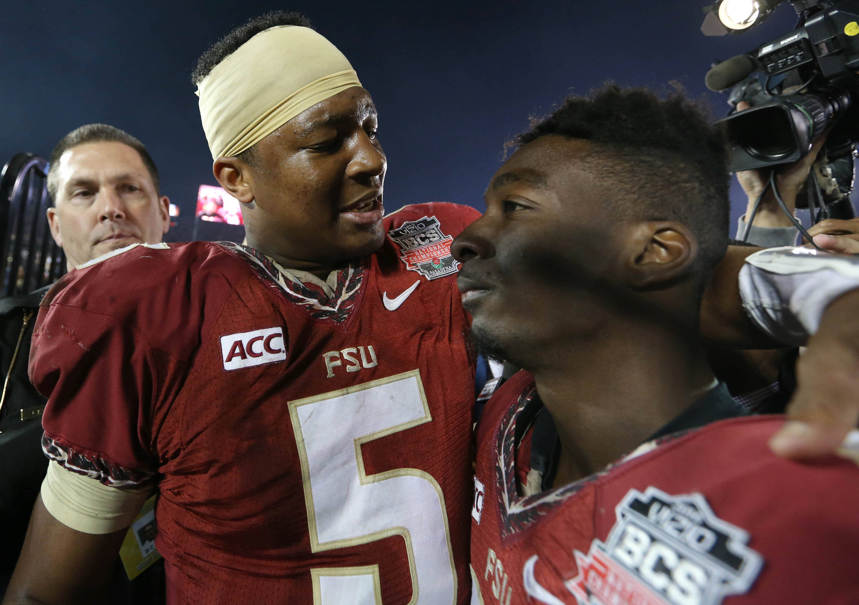 Jan 6, 2014; Pasadena, CA, USA; Florida State Seminoles quarterback Jameis Winston (5) celebrates with Florida State Seminoles wide receiver Kenny Shaw (81) during the second half of the 2014 BCS National Championship game at the Rose Bowl.  Mandatory Credit: Matthew Emmons-USA TODAY Sports